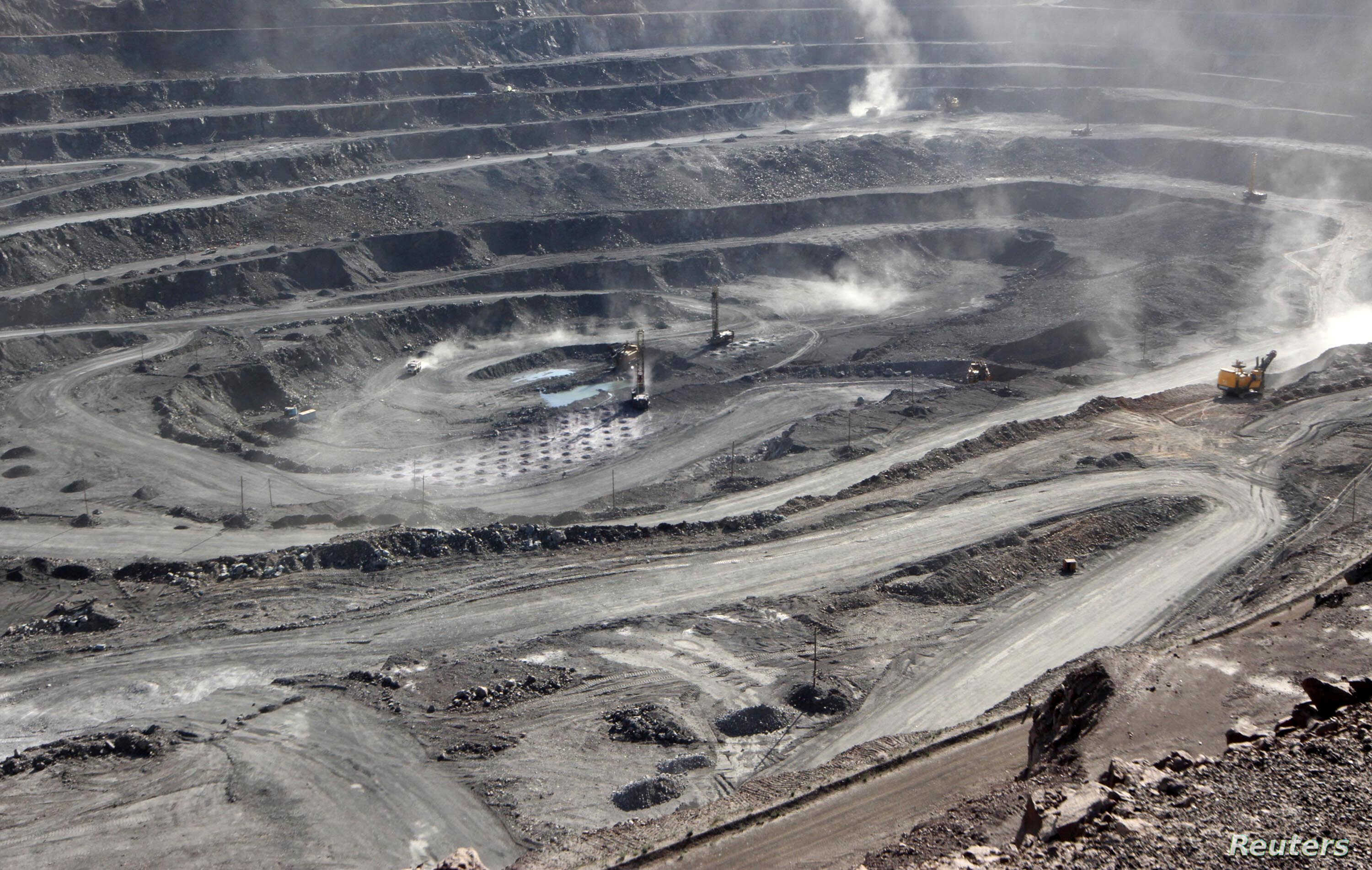 FILE - Miners are seen at the Bayan Obo mine containing rare earth minerals, in Inner Mongolia, China, July 16, 2011.