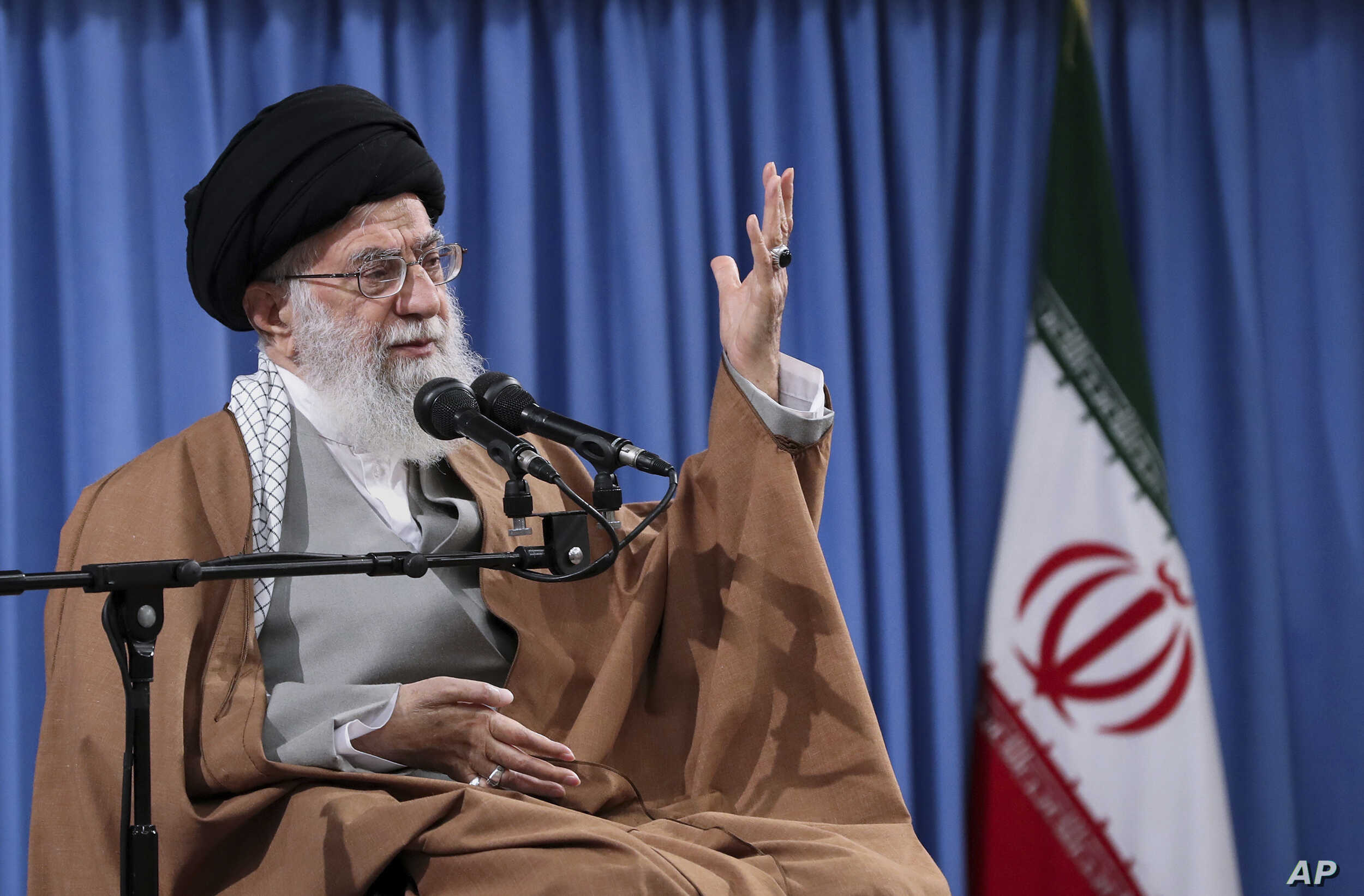 """In this picture released by an official website of the office of the Iranian supreme leader, Ayatollah Ali Khamenei speaks at a meeting with a group of  Revolutionary Guards and their families, in Tehran, Iran, April 9, 2019. Khamenei praised Iran's Revolutionary Guard and said America's """"evil designs would not harm"""" the force after the White House designated the guard a foreign terrorist organization. (Office of the Iranian Supreme Leader via AP)"""