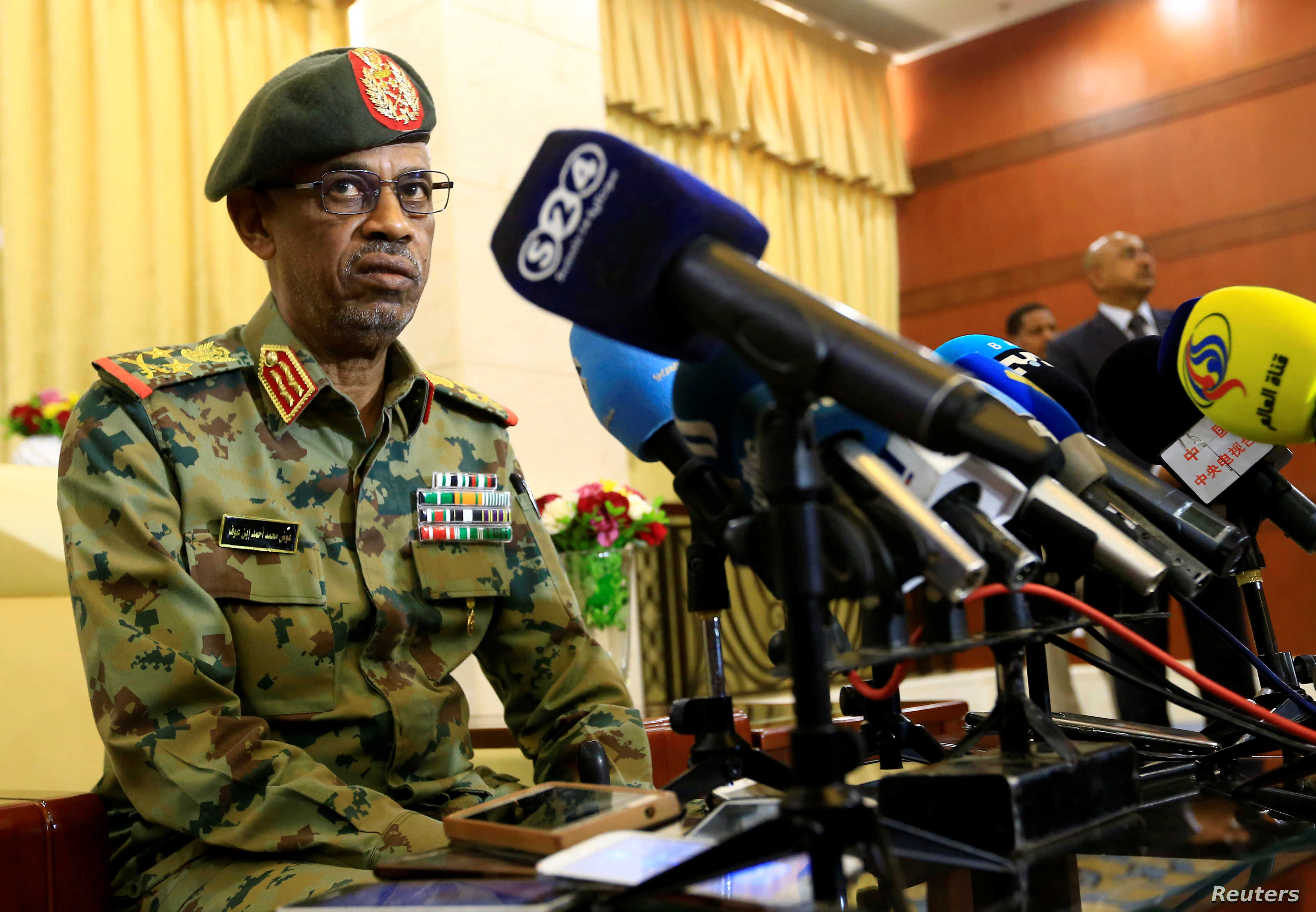 FILE - Major General Awad Mohamed Ahmed Ibn Auf, who was to lead a military council to run Sudan over the next two years, speaks to the media, in Khartoum, Sudan, Feb. 24, 2019. Ibn Auf resigned Friday.