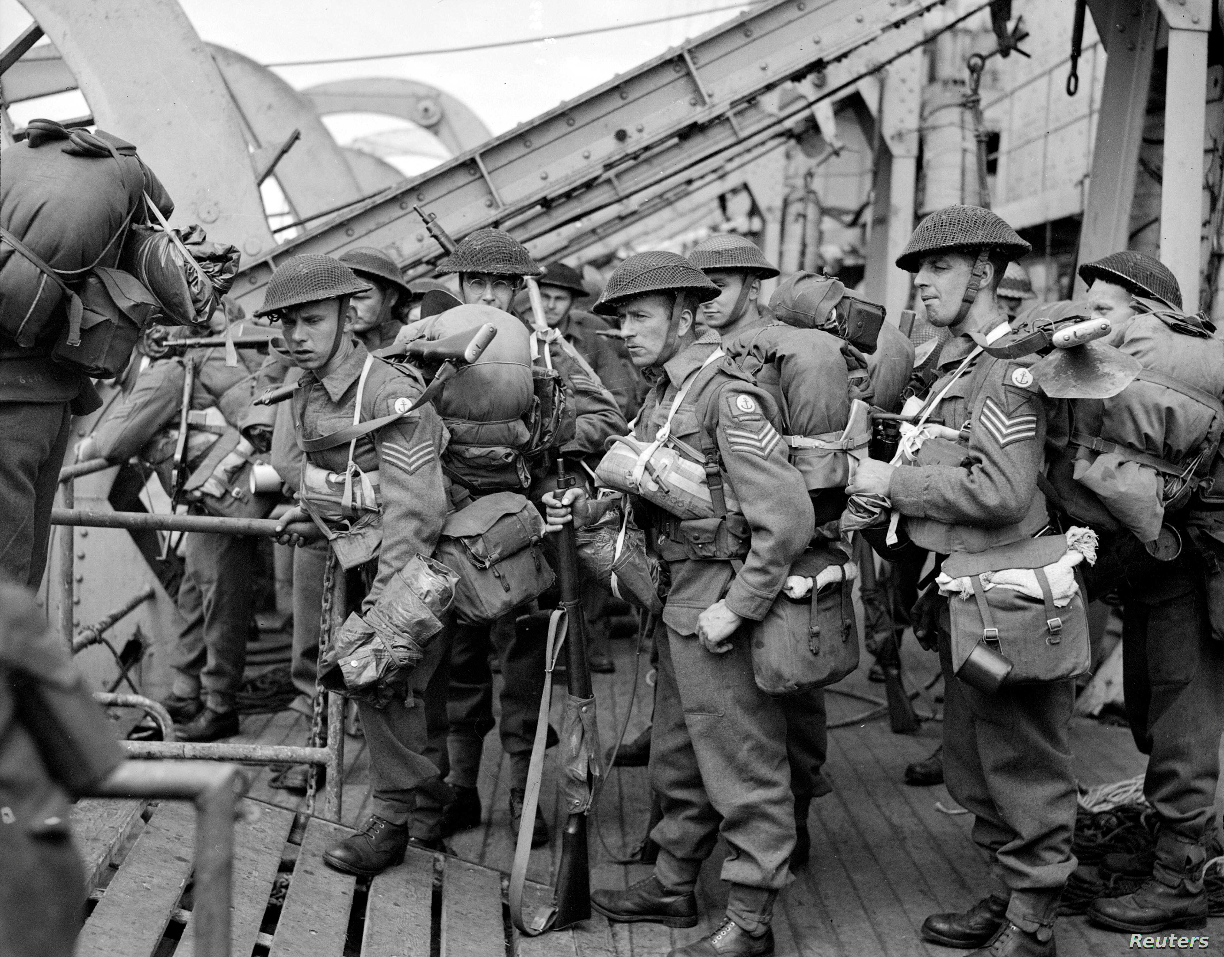 FILE - British troops disembark from an infantry landing ship on D-Day in Normandy, France, June 6, 1944.