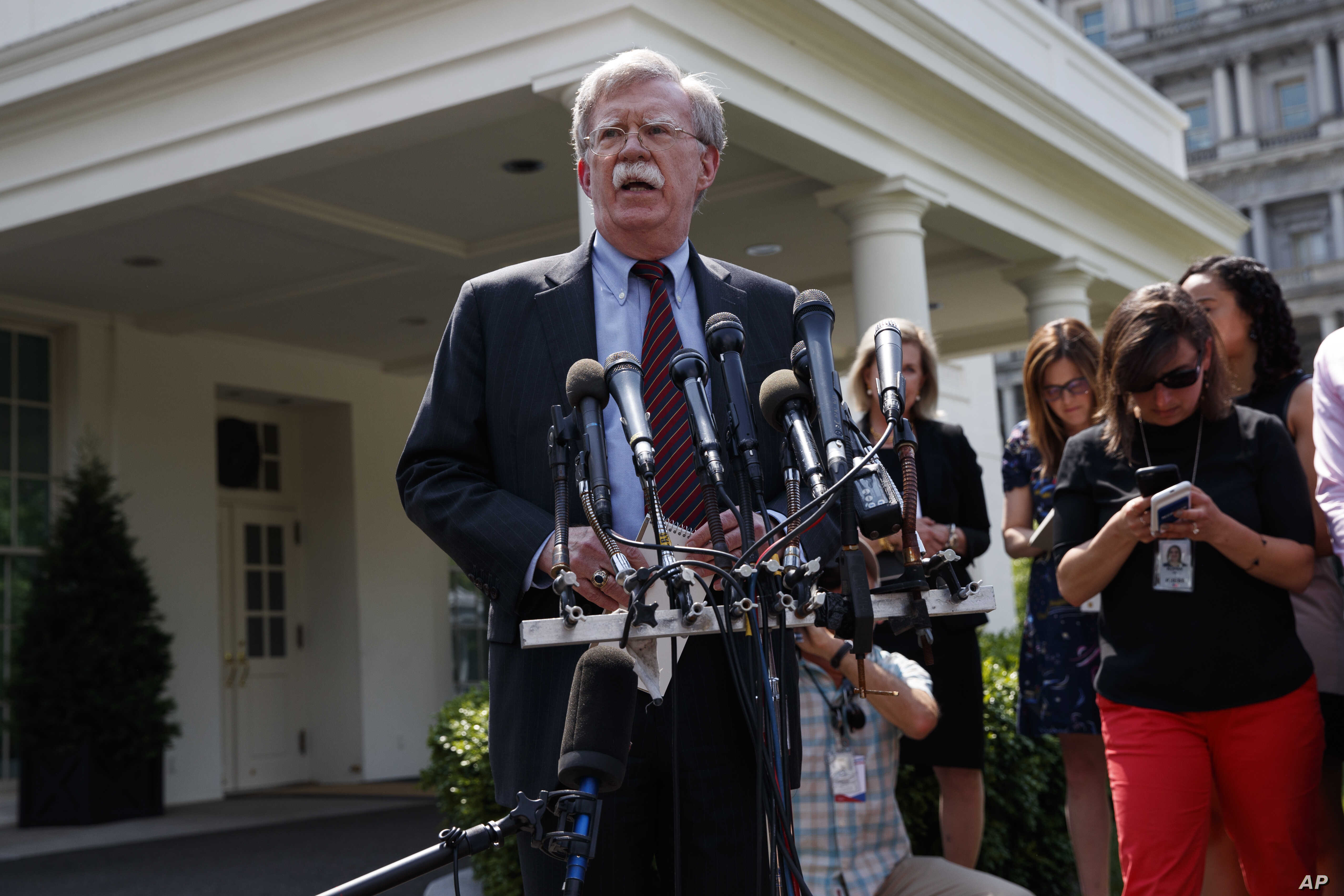 National security adviser John Bolton speaks with reporters outside the White House in Washington about the situation in Venezuela, April 30, 2019.