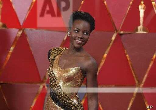 Lupita Nyong'o arrives at the Oscars on Sunday, March 4, 2018, at the Dolby Theatre in Los Angeles.