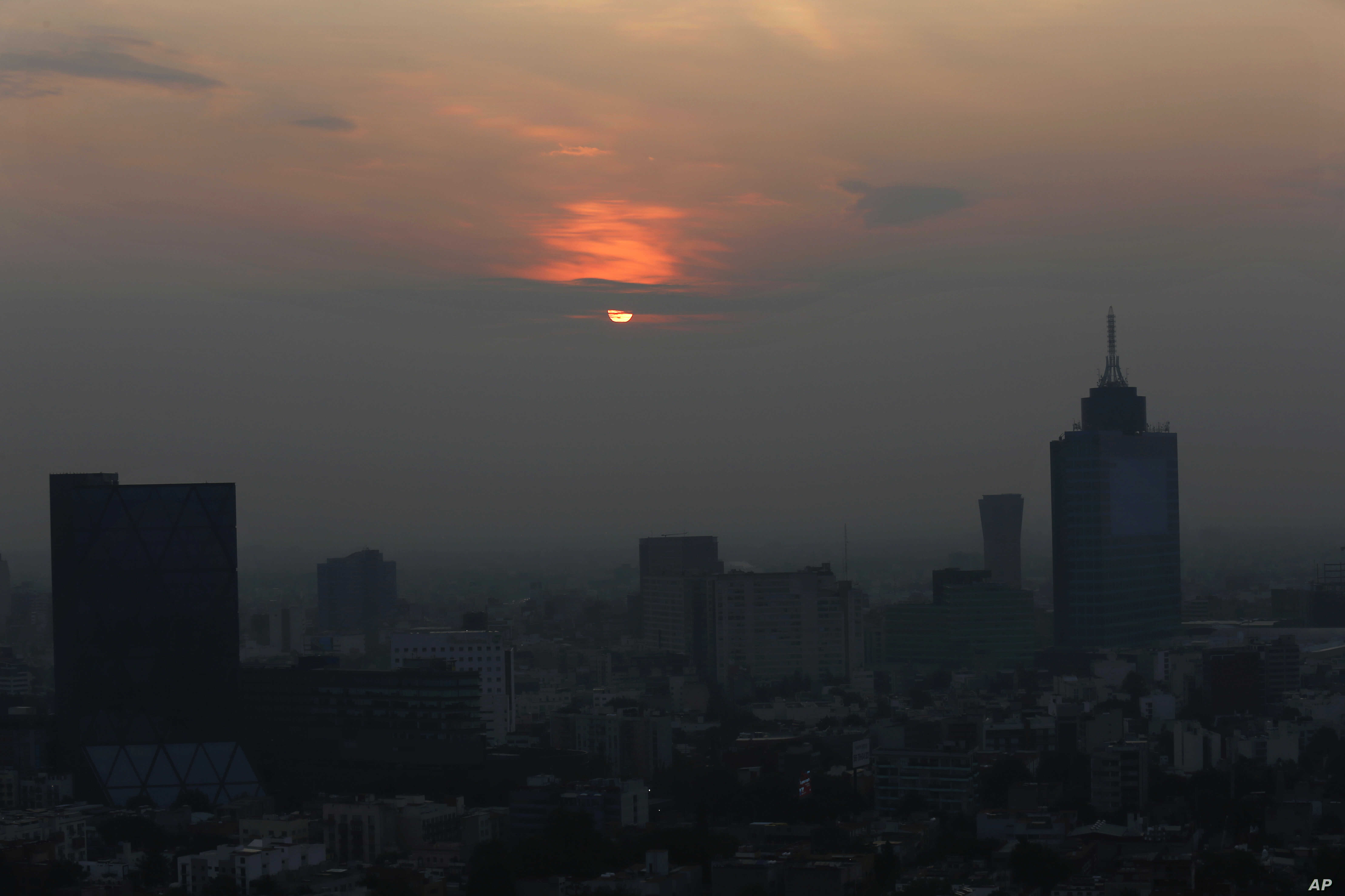 Smog blankets the sky in Mexico City, May 17, 2019. Both lower schools and universities were closed for a third straight day for the pollution alert triggered by smoke from ongoing brush fires combined with the lack of rain.