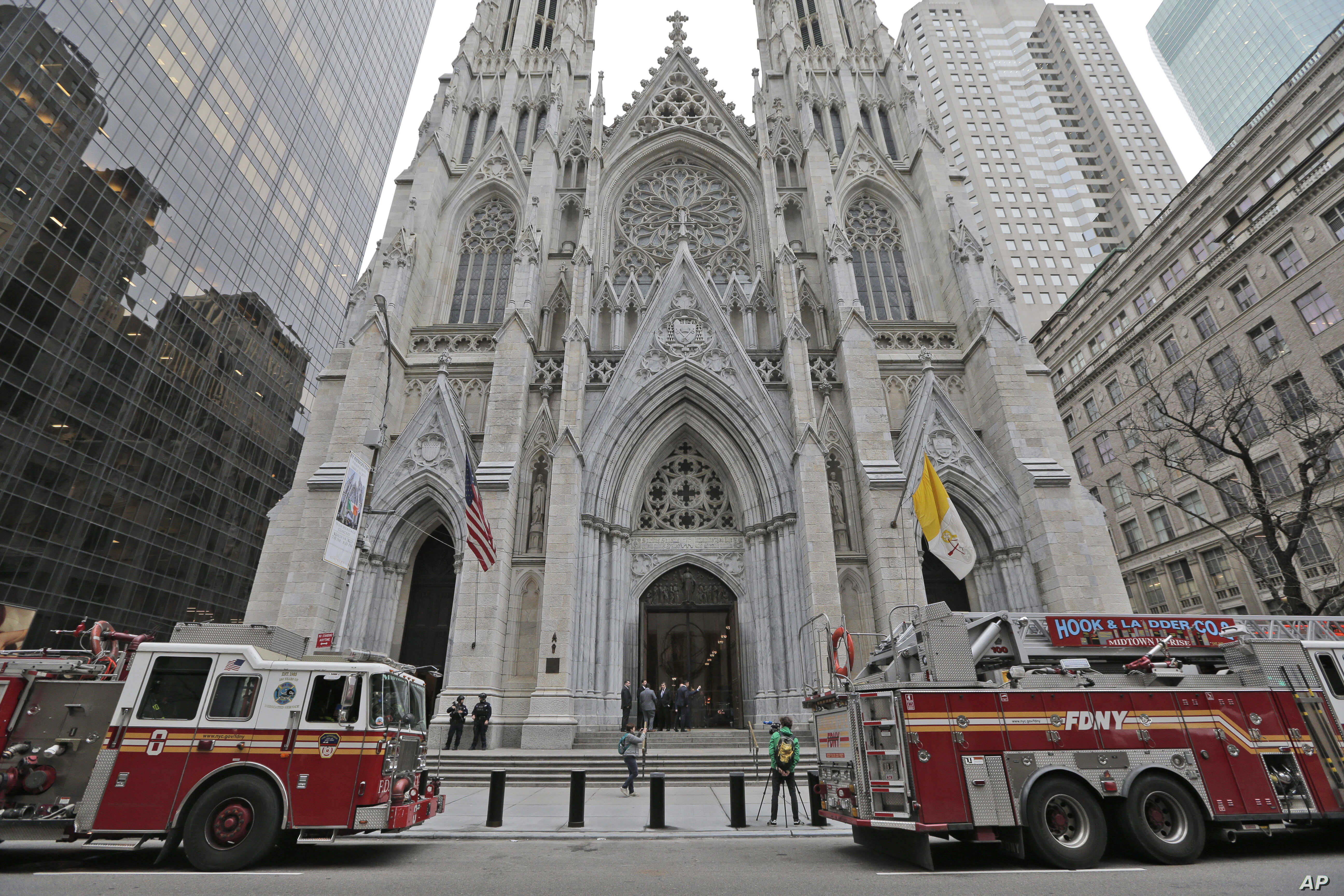 While firemen conduct an inspection, fire trucks are parked in front of St. Patrick's Cathedral in New York, April 18, 2019.