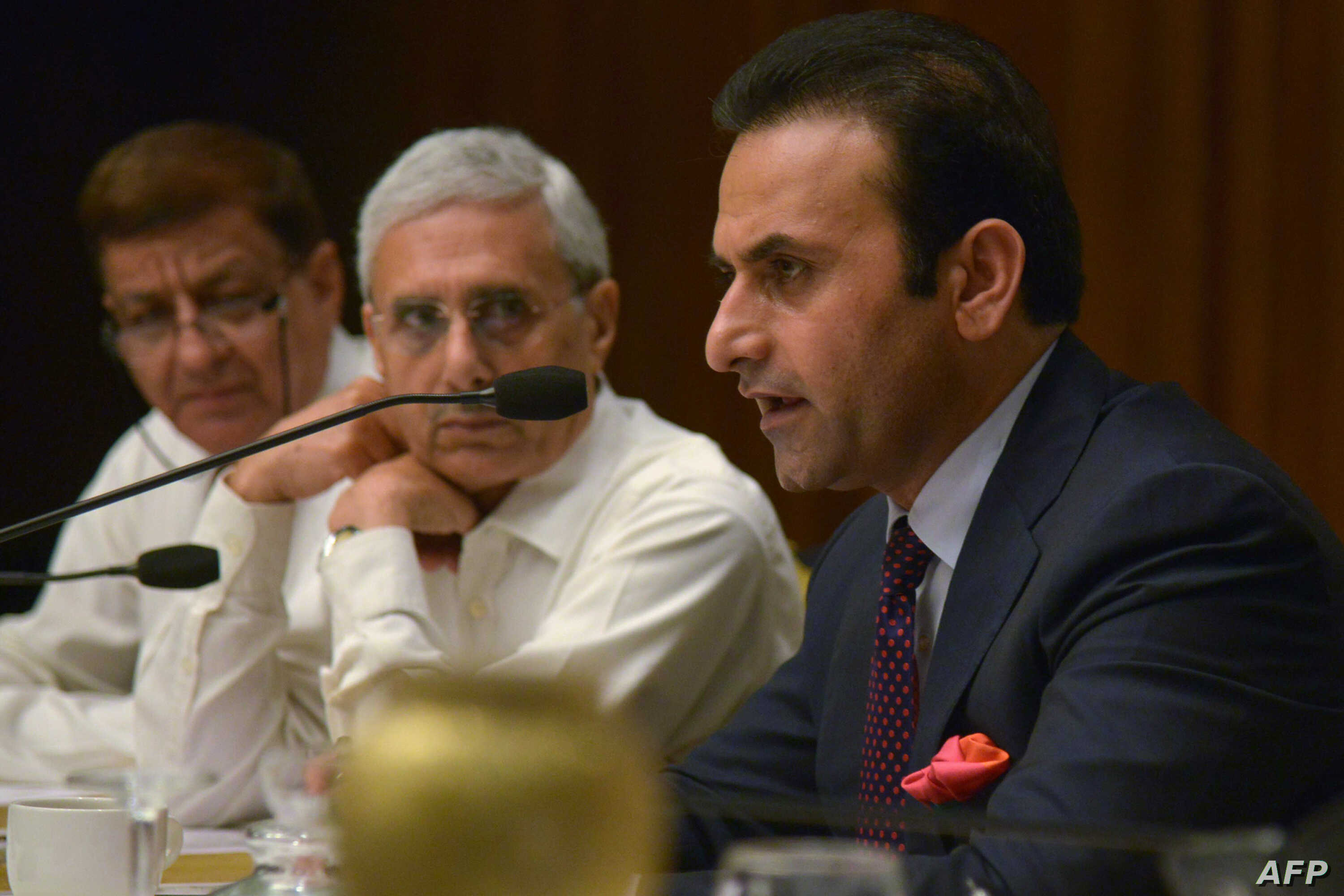 FILE - Afghanistan's then-ambassador to India Shaida Mohammad Abdali, right, speaks at a hotel in Amritsar, Aug. 27, 2015.