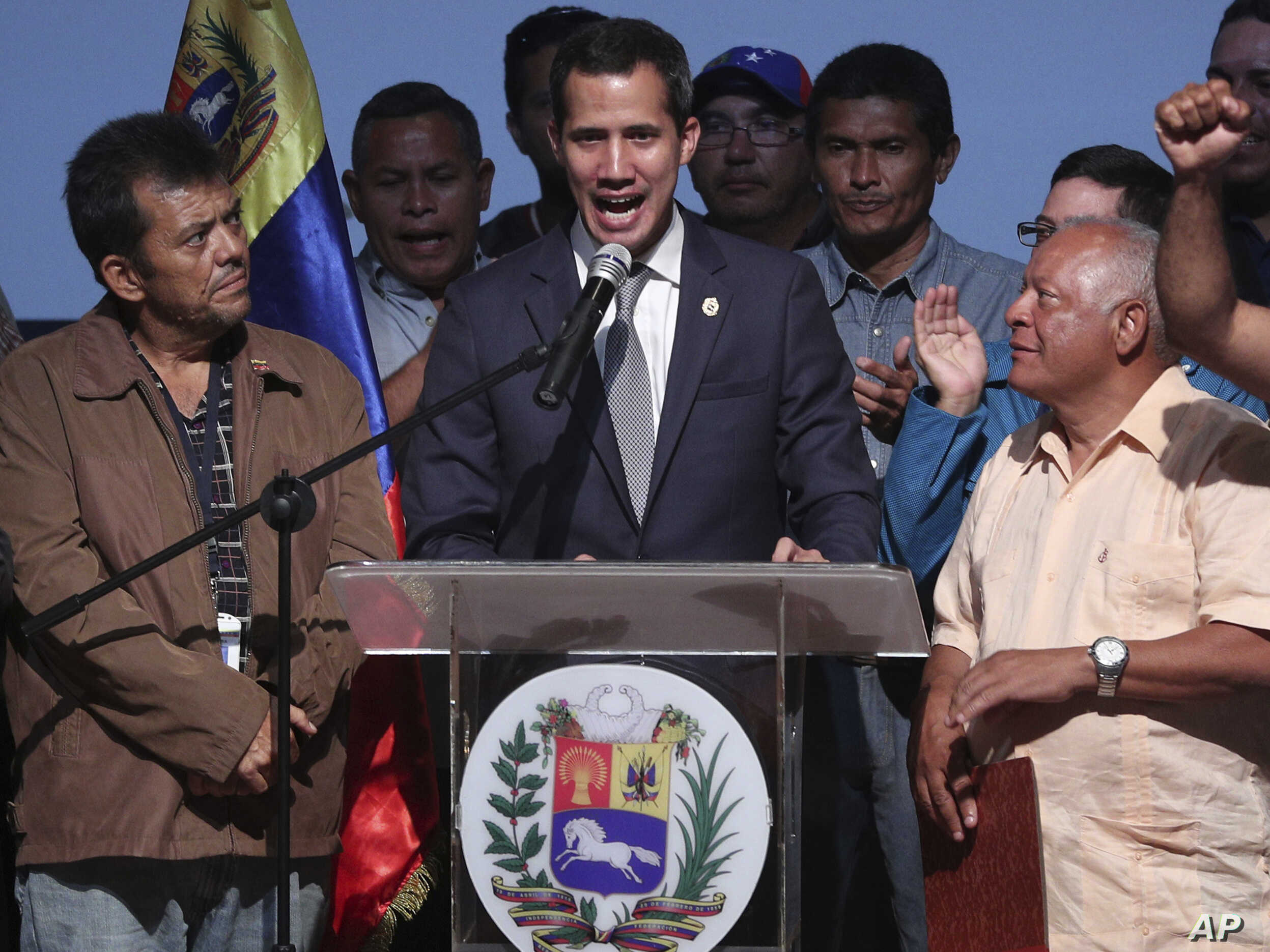 Venezuela's opposition leader and self proclaimed interim President Juan Guaido, center, speaks during a meeting with oil workers at the Metropolitan University of Caracas, Venezuela, May 3, 2019.