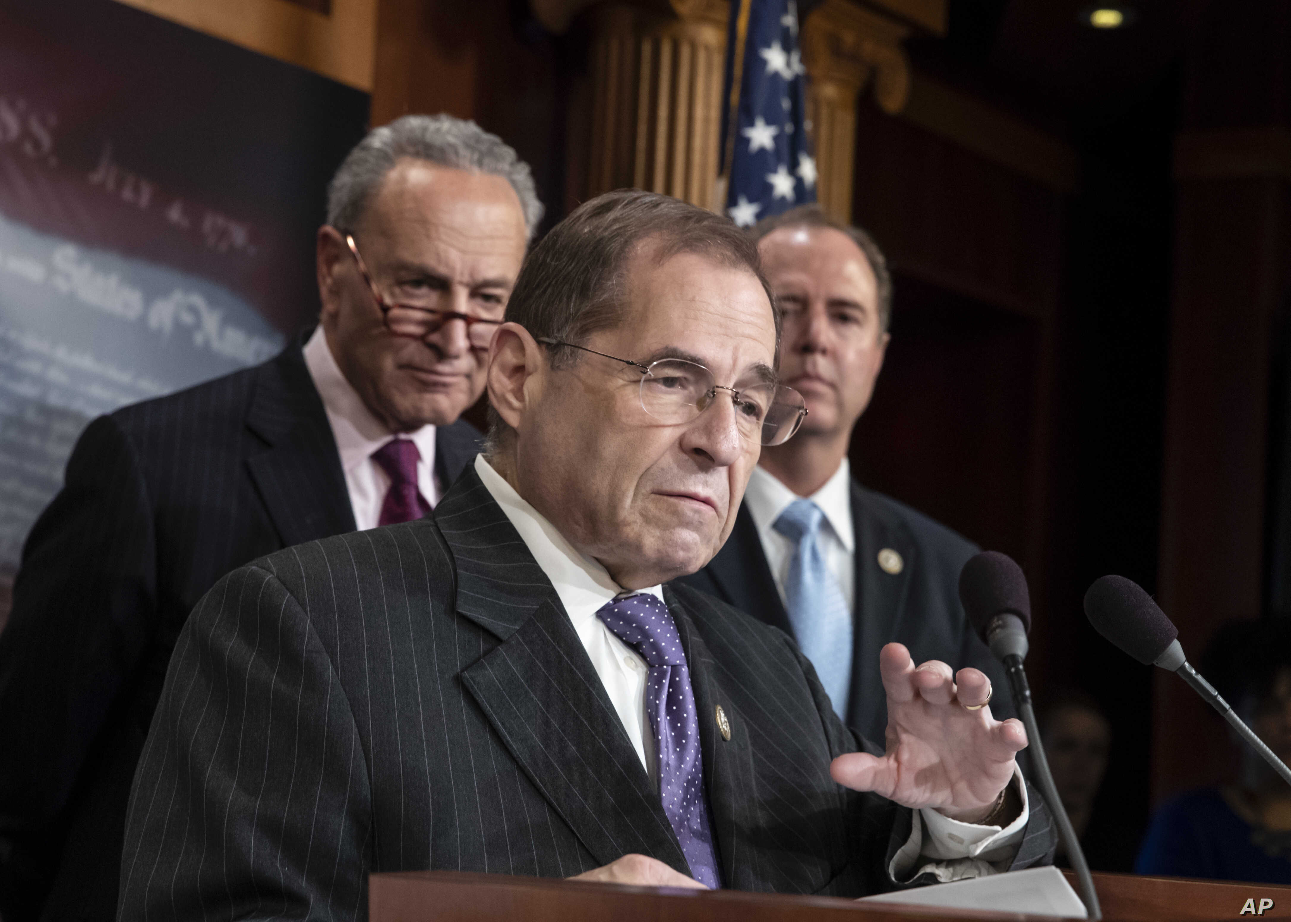 FILE - Rep. Jerrold Nadler, D-N.Y., center, flanked by Senate Minority Leader Chuck Schumer, D-N.Y., left, and Rep. Adam Schiff, D-Calif., speaks on Capitol Hill in Washington, June 14, 2018.