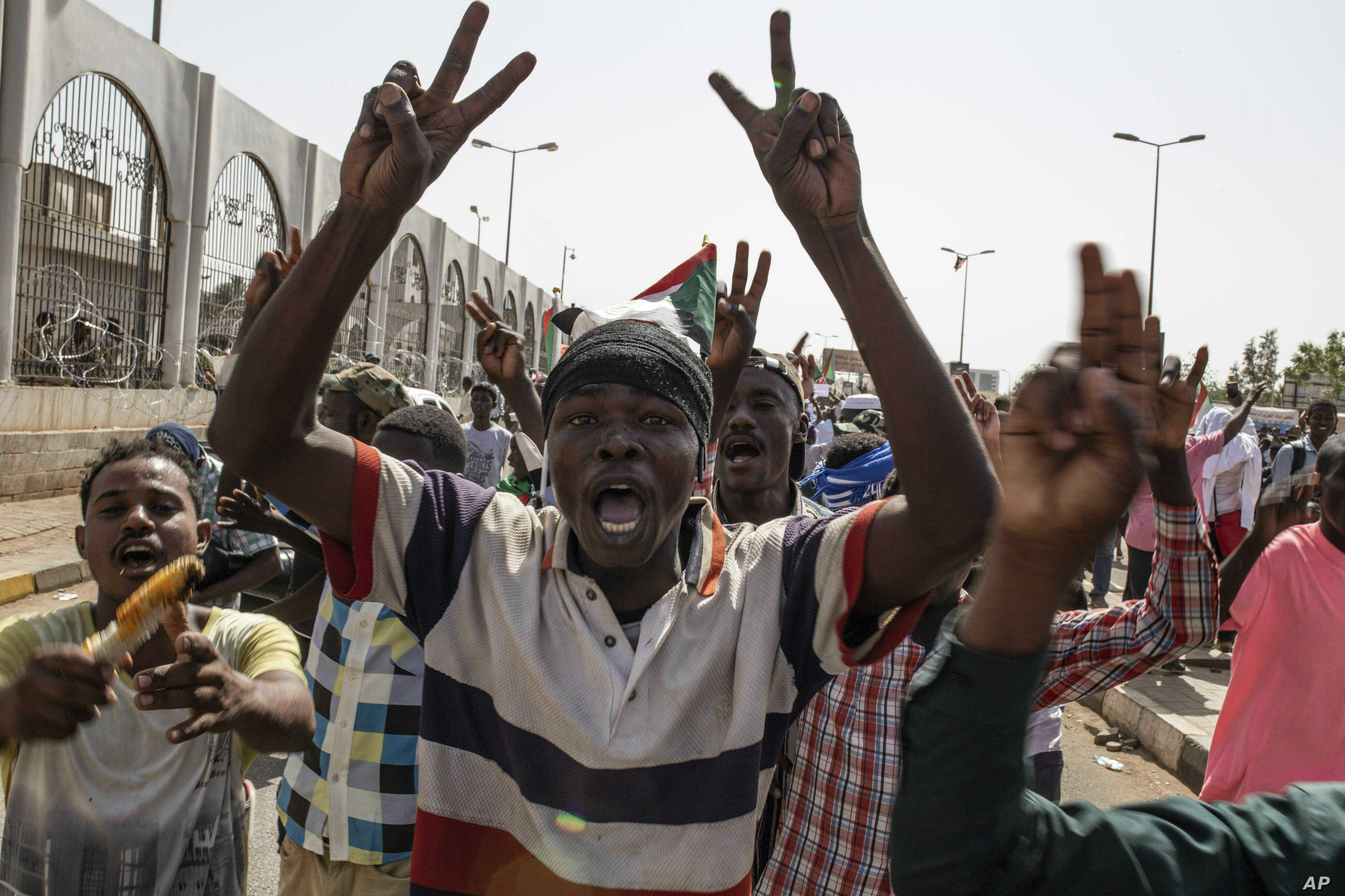 A group of protesters chant revolutionary slogans against military rule at the sit-in outside the military headquarters, in Khartoum, Sudan, Thursday, May 2, 2019.