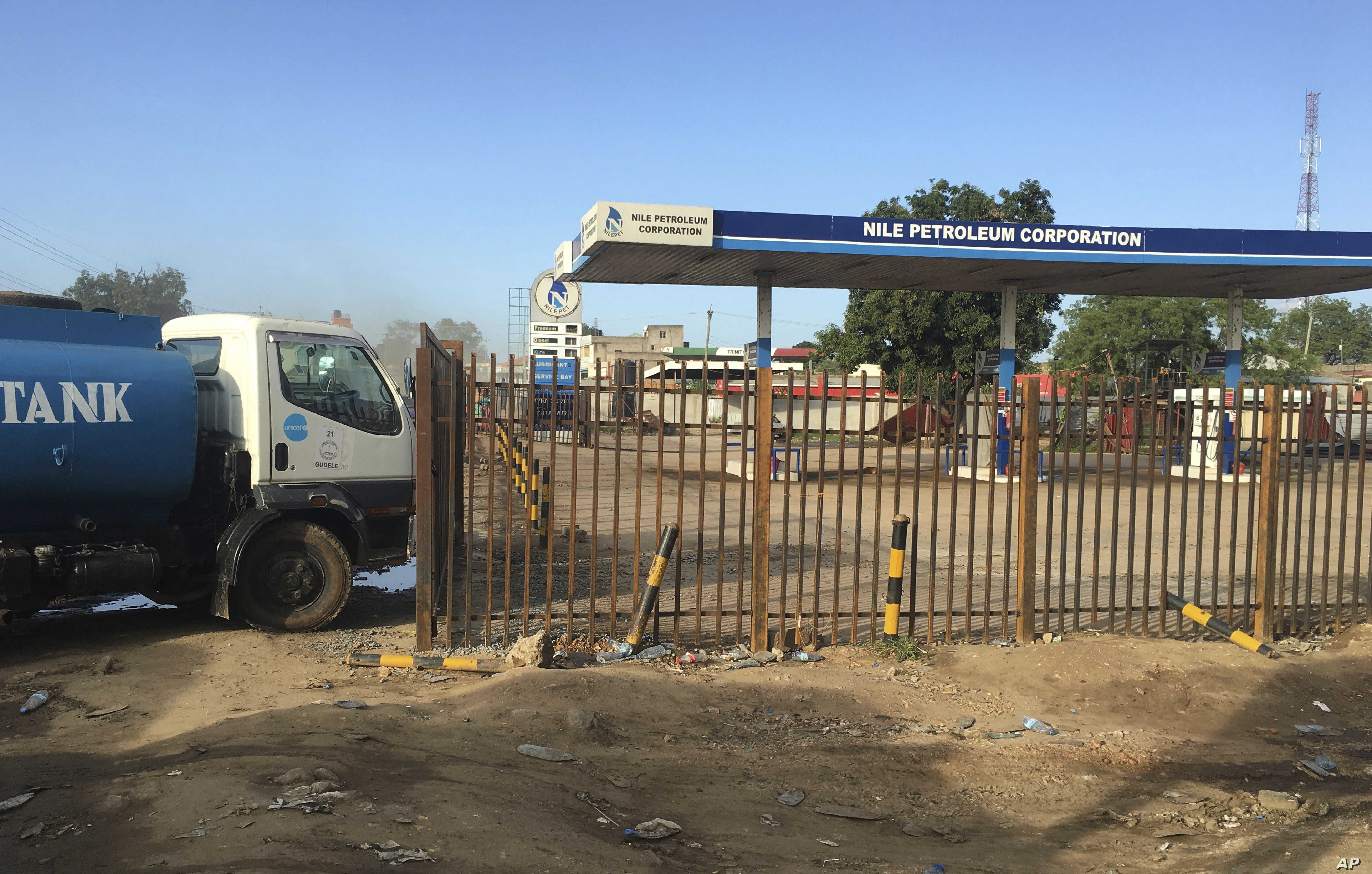 FILE - A truck waits outside a petrol station of the Nile Petroleum Corporation in Juba, South Sudan, Oct. 1, 2017.