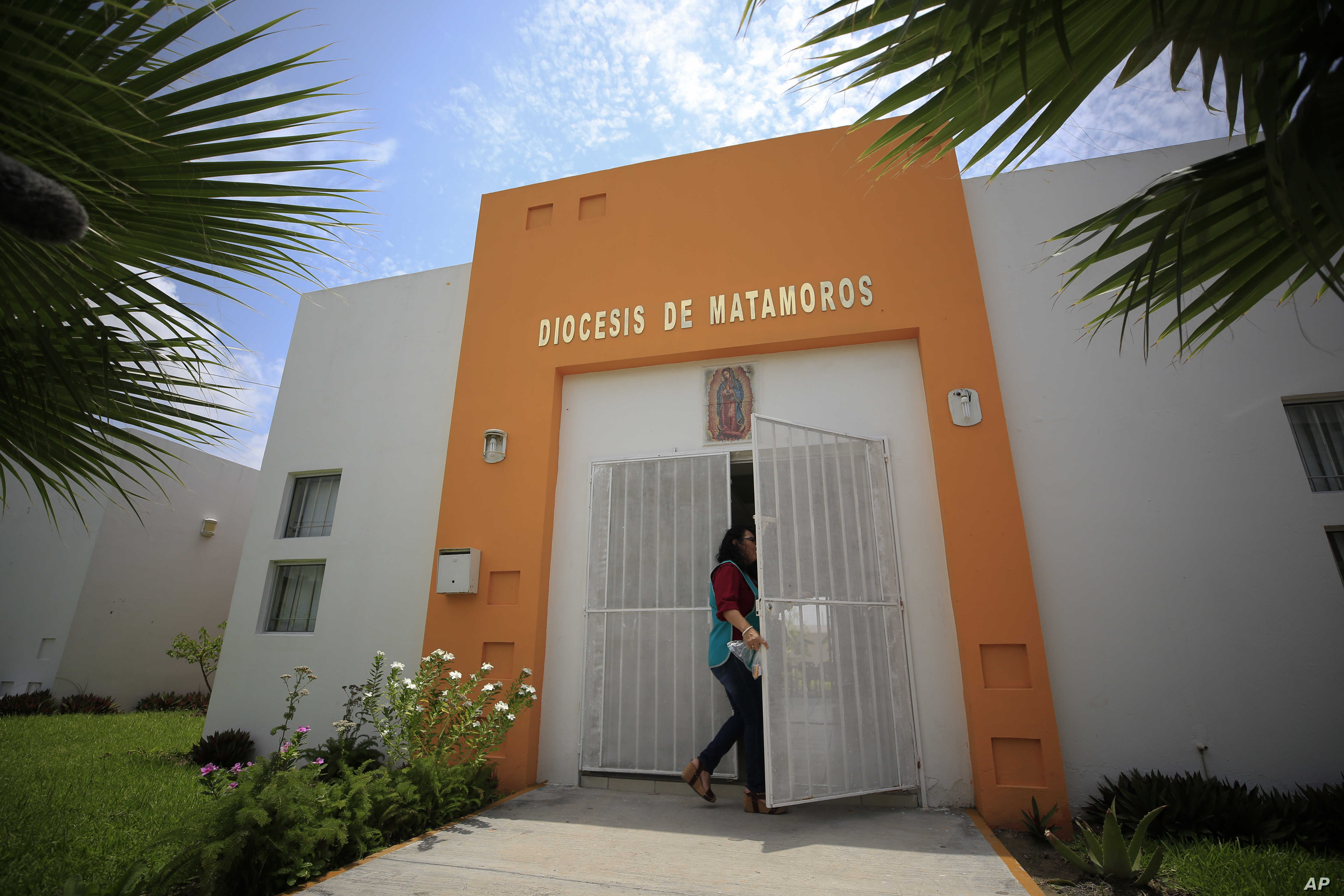 A worker enters the migrant shelter where Tania Vanessa Avalos has been receiving assistance since her husband and their nearly two-year-old daughter drowned Sunday when the family tried to cross the Rio Grande in Matamoros, Tamaulipas state, Mexico, June 26, 2019.