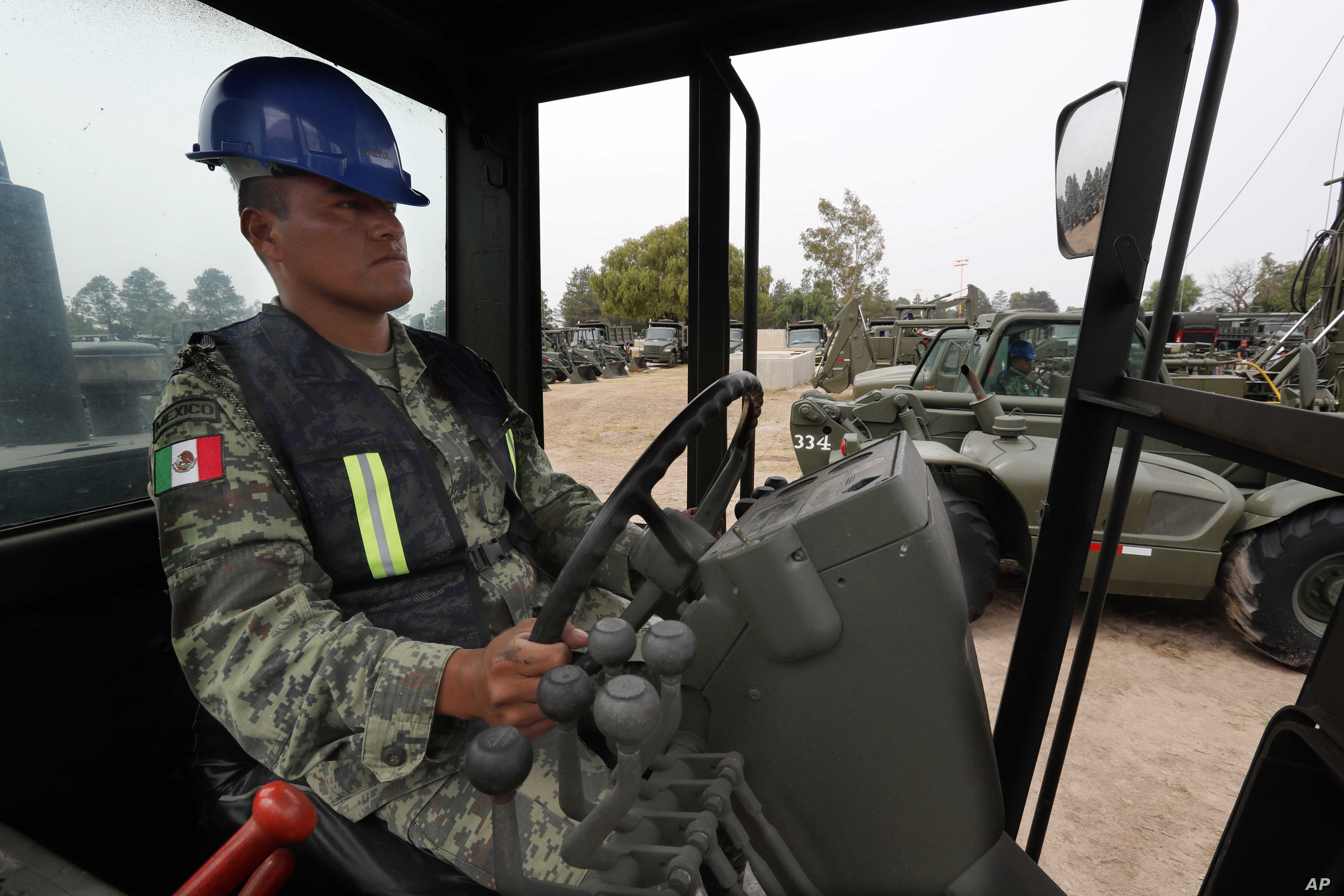 A Mexican army soldier drives a motor grader during the launch of the construction of Mexico City's new airport at the Military Airbase Number 1 in Santa Lucia, on the outskirts of Mexico City, April 29, 2019.