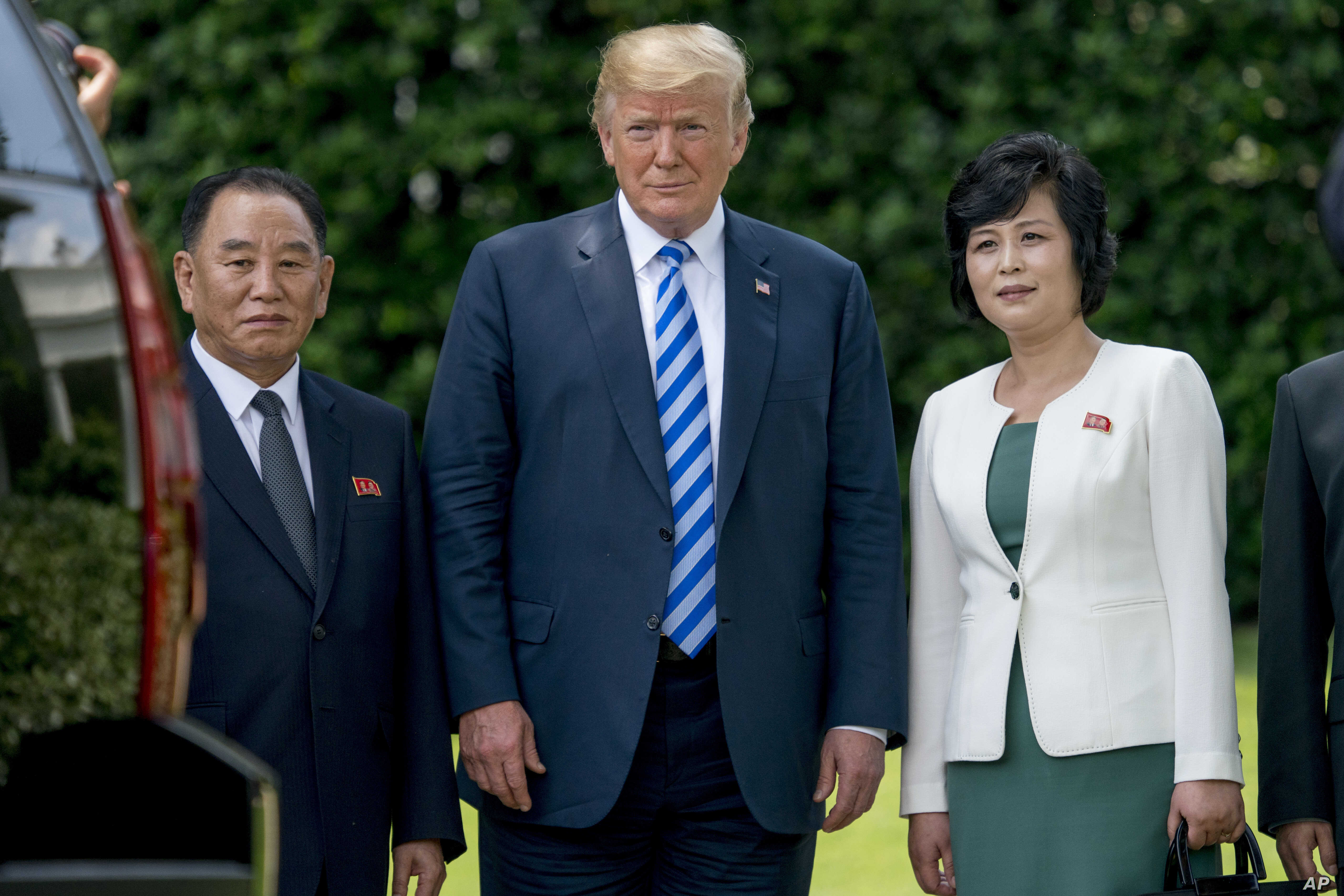 FILE - From left, former North Korean military intelligence chief Kim Yong Chol, President Donald Trump, and Kim Song Hye, head of the Committee for the Peaceful Reunification of Korea of the Korean Workers' Party, pose for a photograph outside the O...