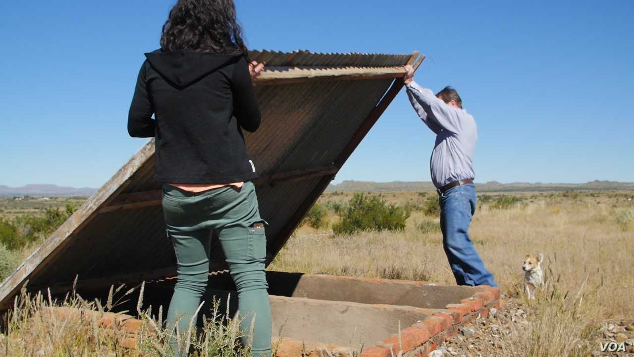 Suidlanders spokesman Simon Roche shows an empty grave in an unused piece of farmland where the group can store survival equipment when the hypothetical race war starts.