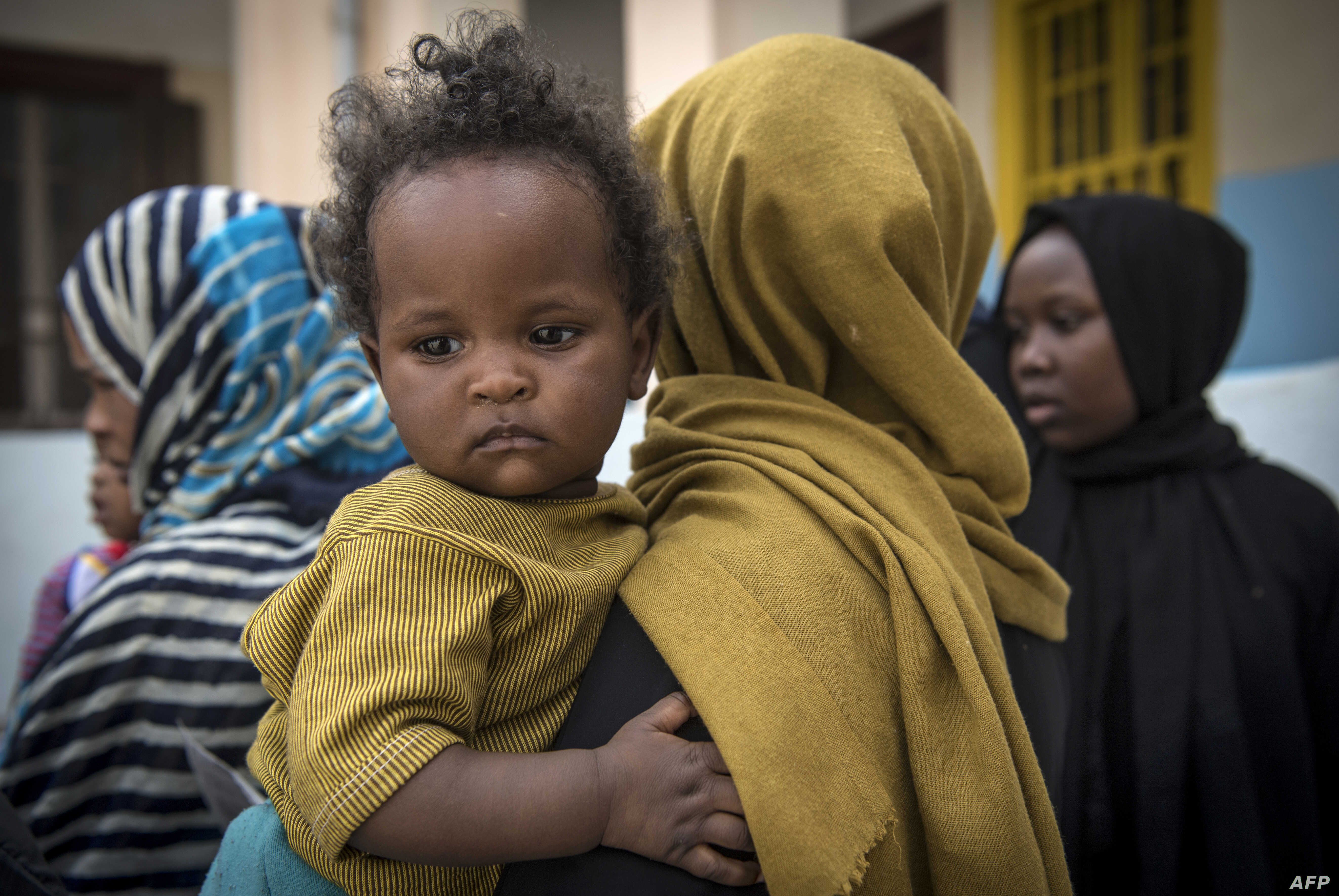 Sudanese refugees, who fled from the clashes between forces loyal to the internationally recognized Government of National Accord and forces loyal to strongman Khalifa Haftar, rest at a school in Libya's capital, Tripoli, on April 24, 2019.