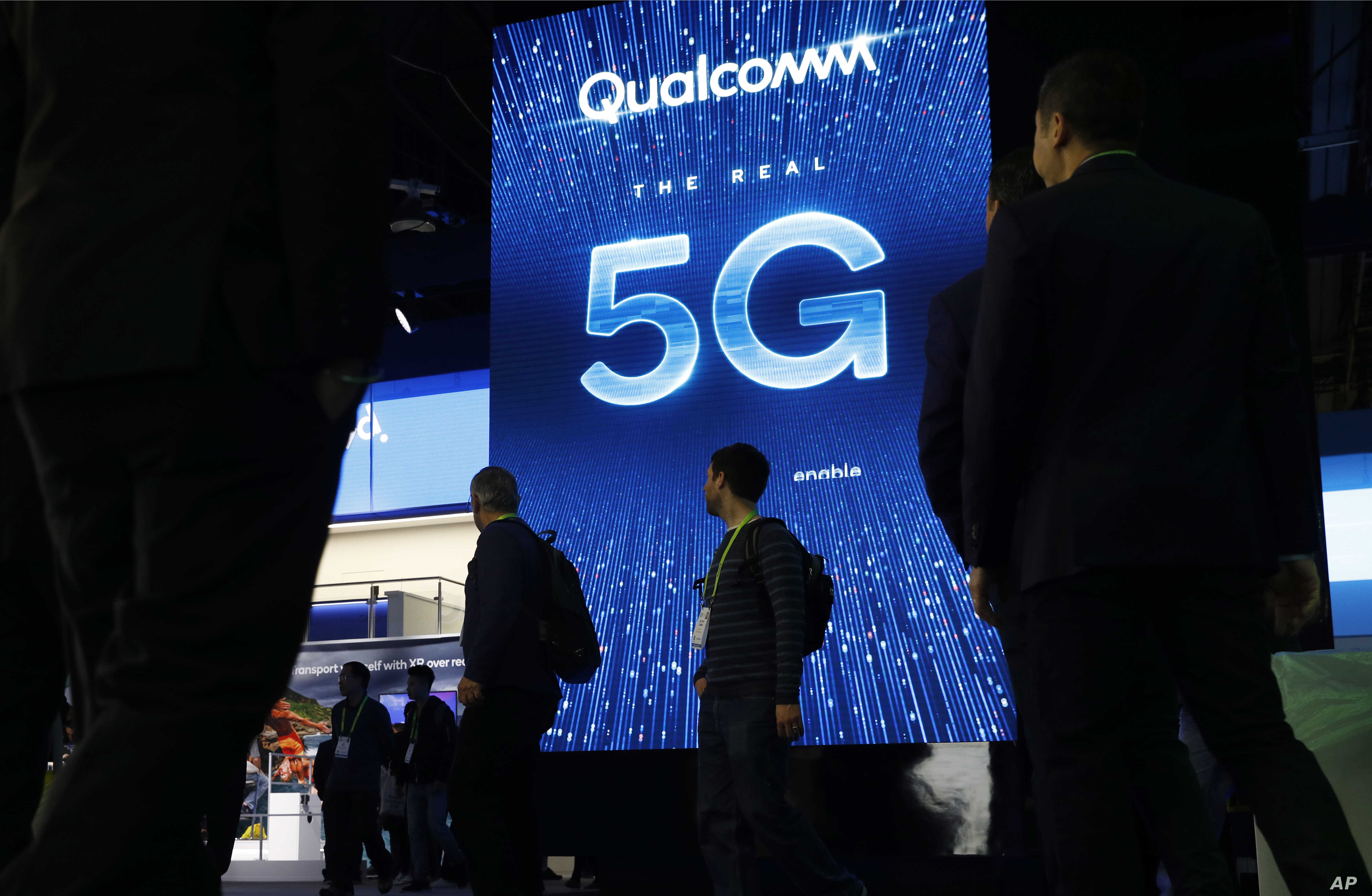 A sign advertises 5G at the Qualcomm booth at CES International, Wednesday, Jan. 9, 2019, in Las Vegas. (AP Photo/John Locher)