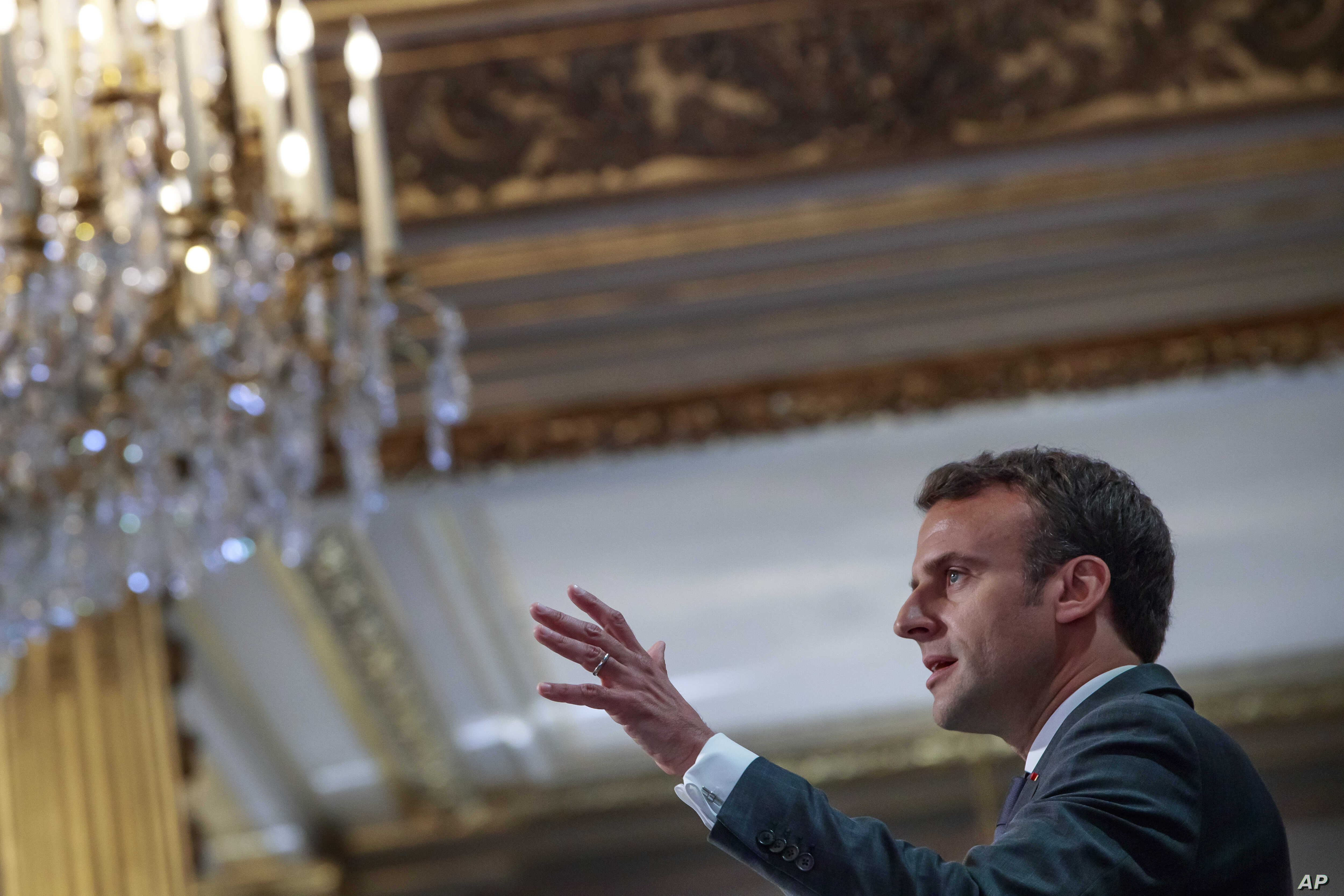 French President Emmanuel Macron addresses Paris Firefighters' brigade and security forces who took part at the fire extinguishing operations of the Notre Dame of Paris Cathedral fire, at the Elysee Palace in Paris, April 18, 2019.