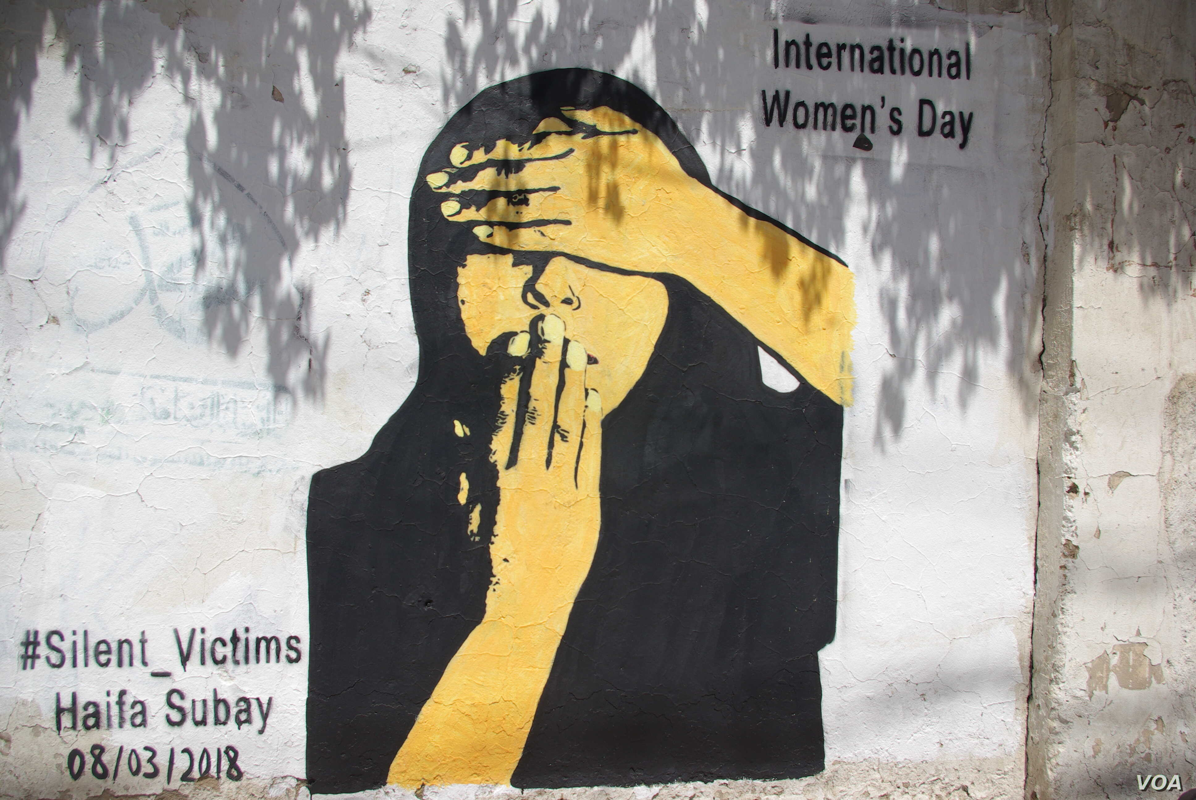"""This mural titled """"Silent Victims"""" by Yemeni artist Haifa Subay shows a woman unable to see or speak. The U.N. Population Fund warns that women in Yemen are paying the heaviest price in the conflict."""
