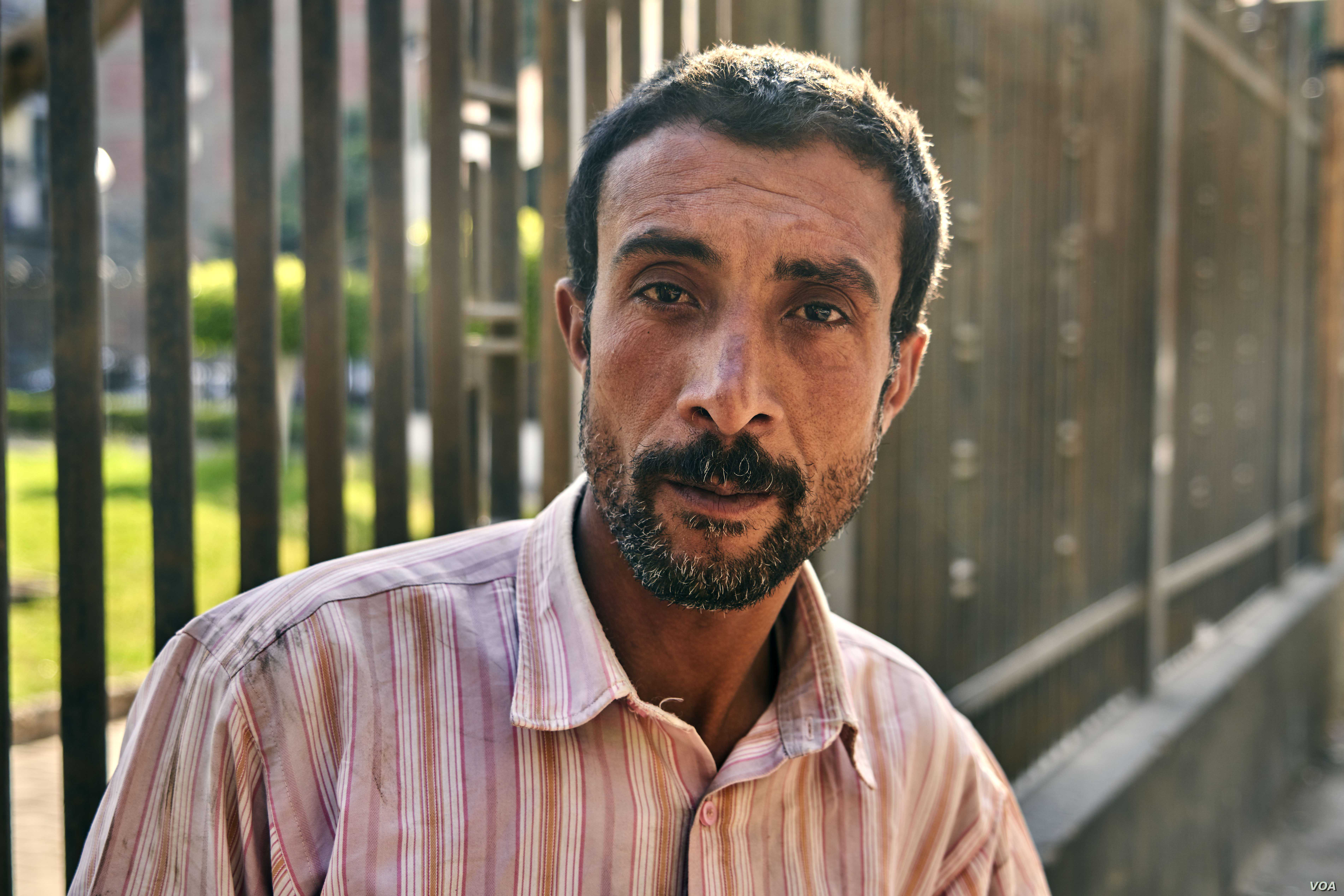 """This man says he won't vote because """"The offer of the food bag is not enough for me to take time off of work"""" on April 20, 2019 in Cairo."""