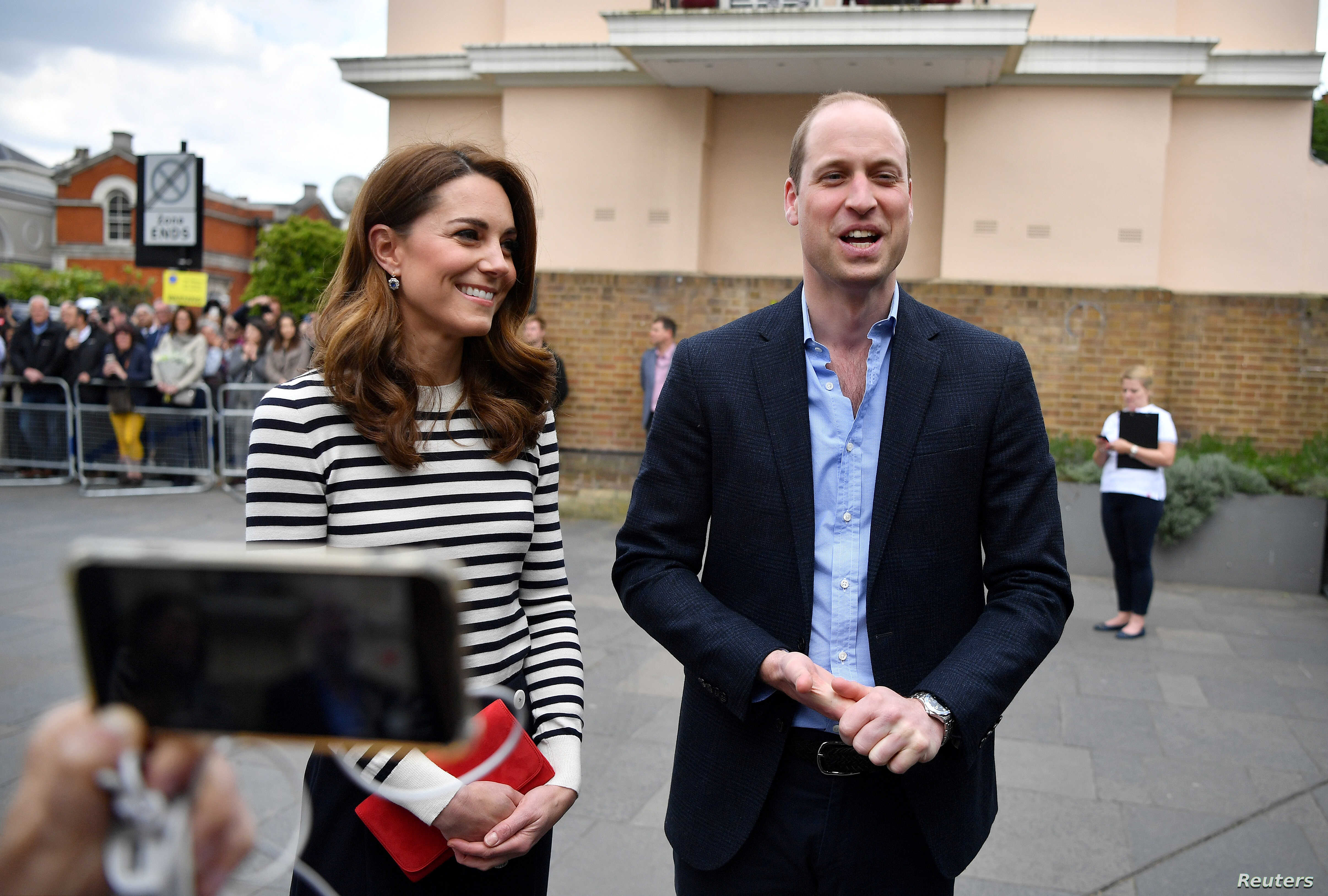 Britain's Prince William and Catherine Duchess of Cambridge talk to members of the media about their newborn nephew, as they arrive to launch the King's Cup Regatta in London, Britain, May 7, 2019.