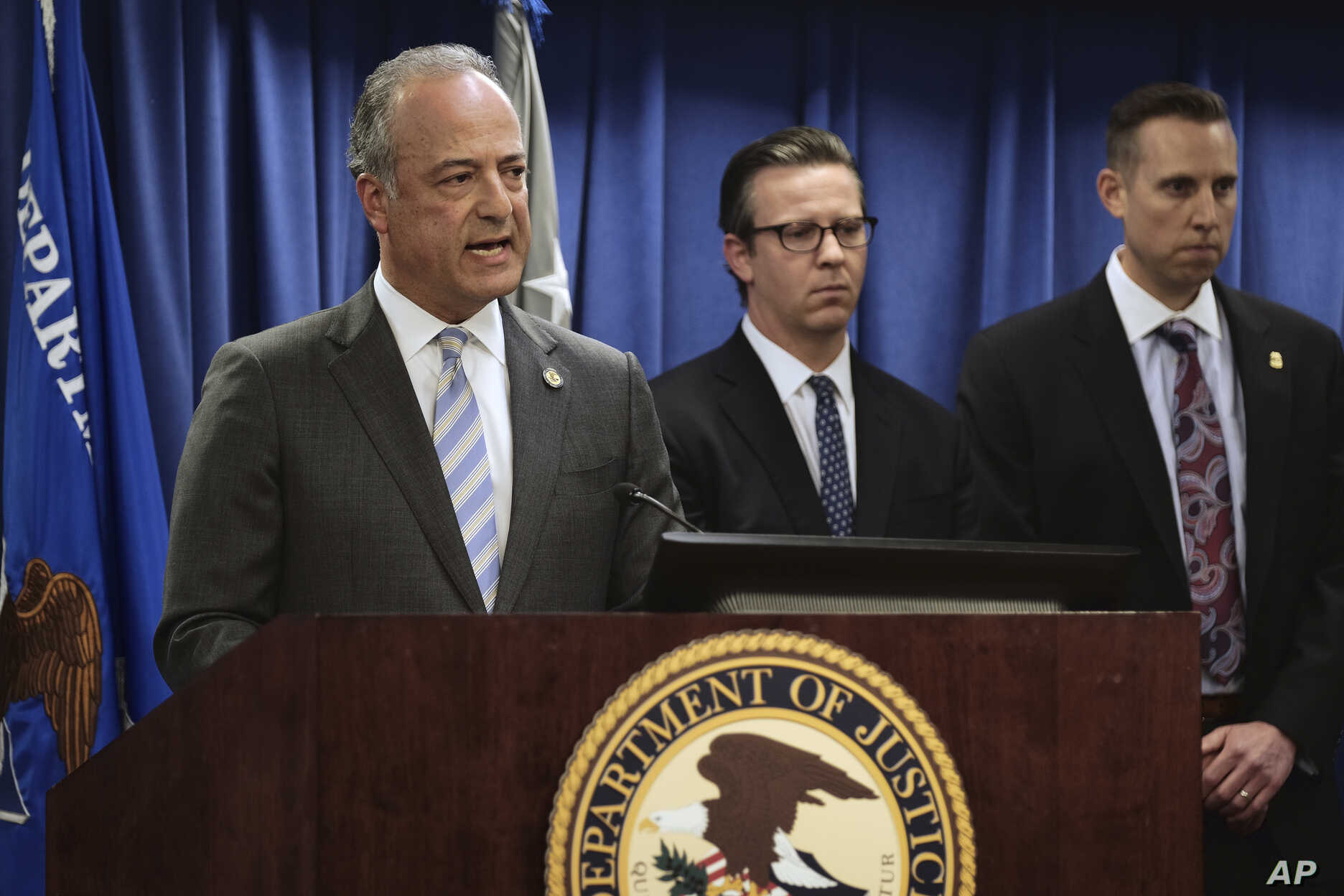 United States Attorney Nick Hanna, left, announces the latest on new federal charges against attorney Michael Avenatti during a news conference in Los Angeles, April 11, 2019.