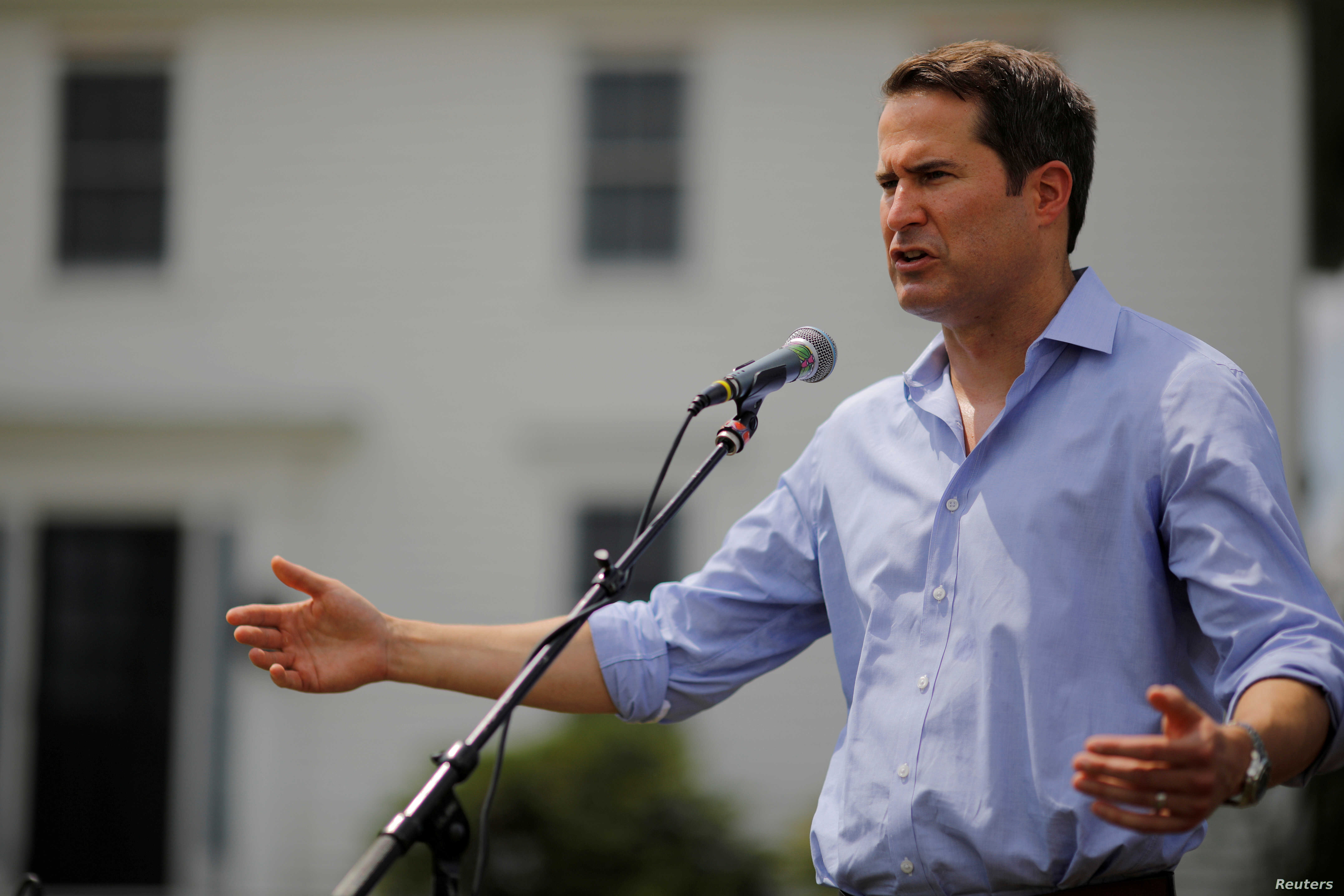 FILE - Congressman Seth Moulton (D-MA) speaks at a Merrimack County Democrats Summer Social at the Swett home in Bow, New Hampshire,  July 28, 2018.