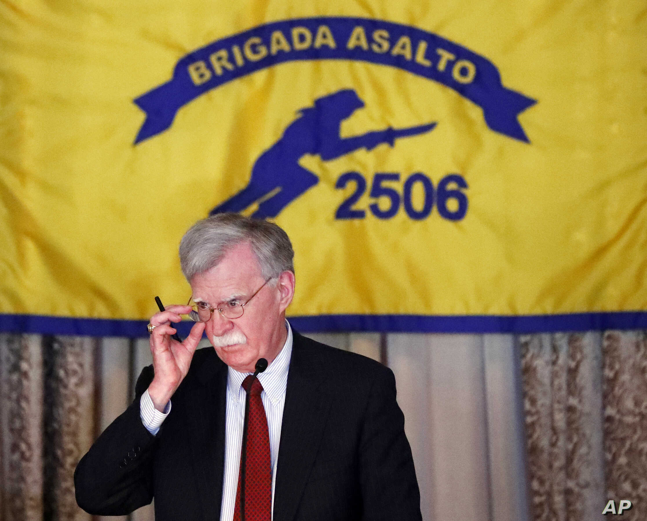 National Security Adviser John Bolton gestures while discussing new administration policy during a speech April 17, 2019, in Coral Gables, Fla., at the Bay of Pigs Veterans Association on the 58th anniversary of the United States' failed 1961 invasio...