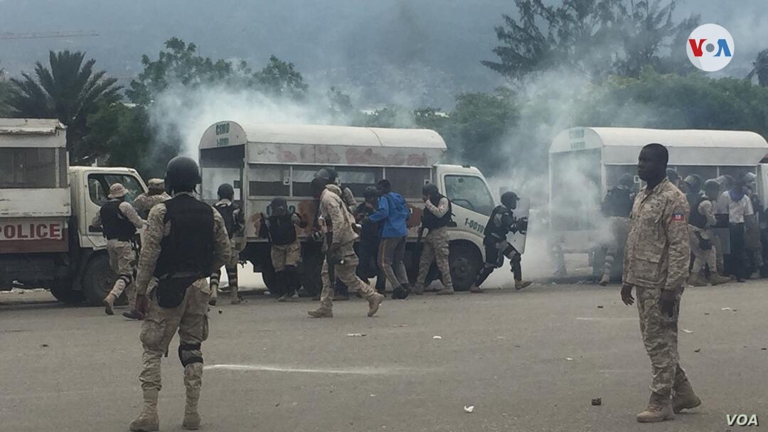 Police fire tear gas to disperse protesters in front of the parliament building in Port au Prince, Haiti, May 30, 2019.