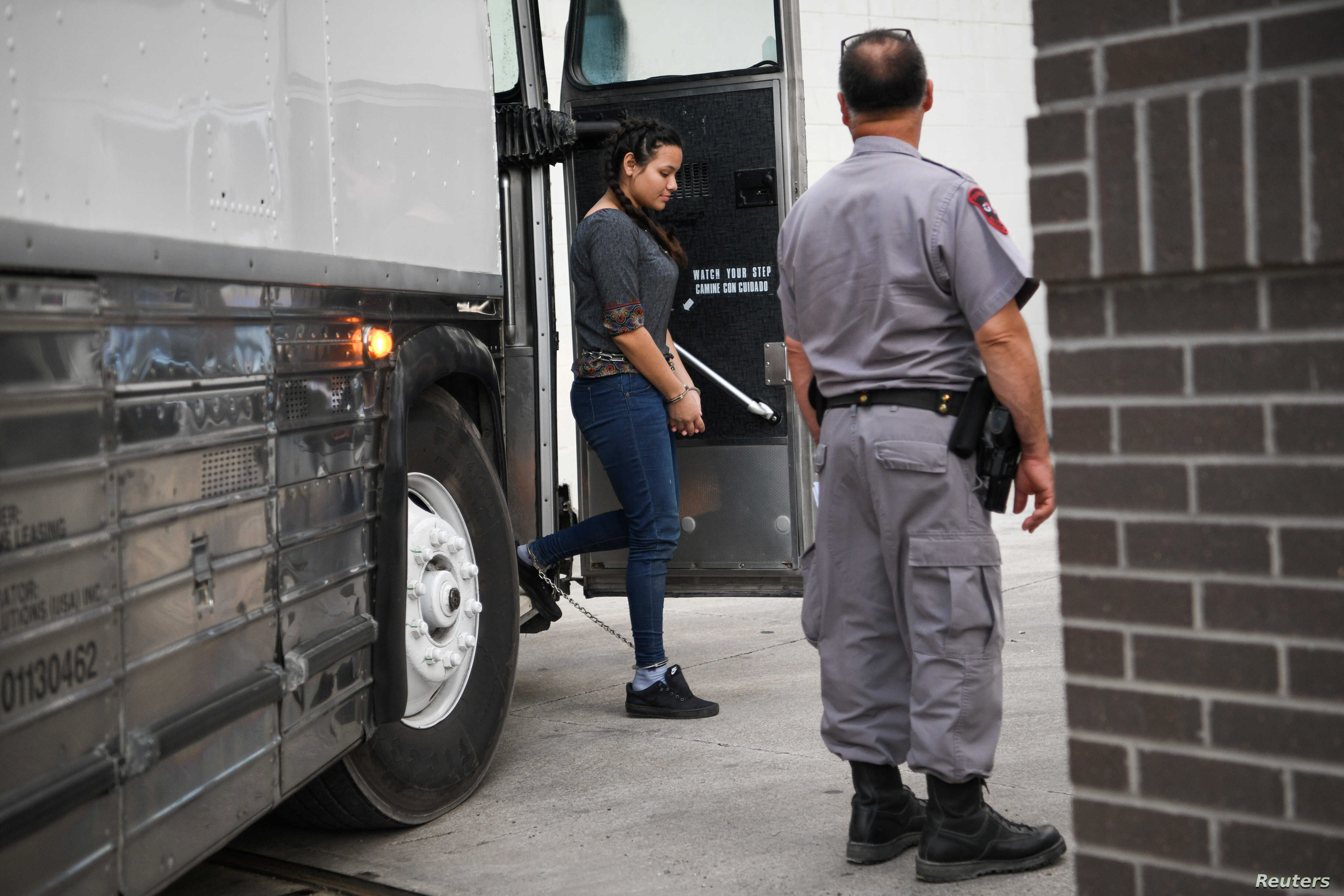 A shackled migrant woman in federal custody arrives for an immigration hearing at the U.S. federal courthouse in McAllen, Texas, U.S., May 20, 2019.