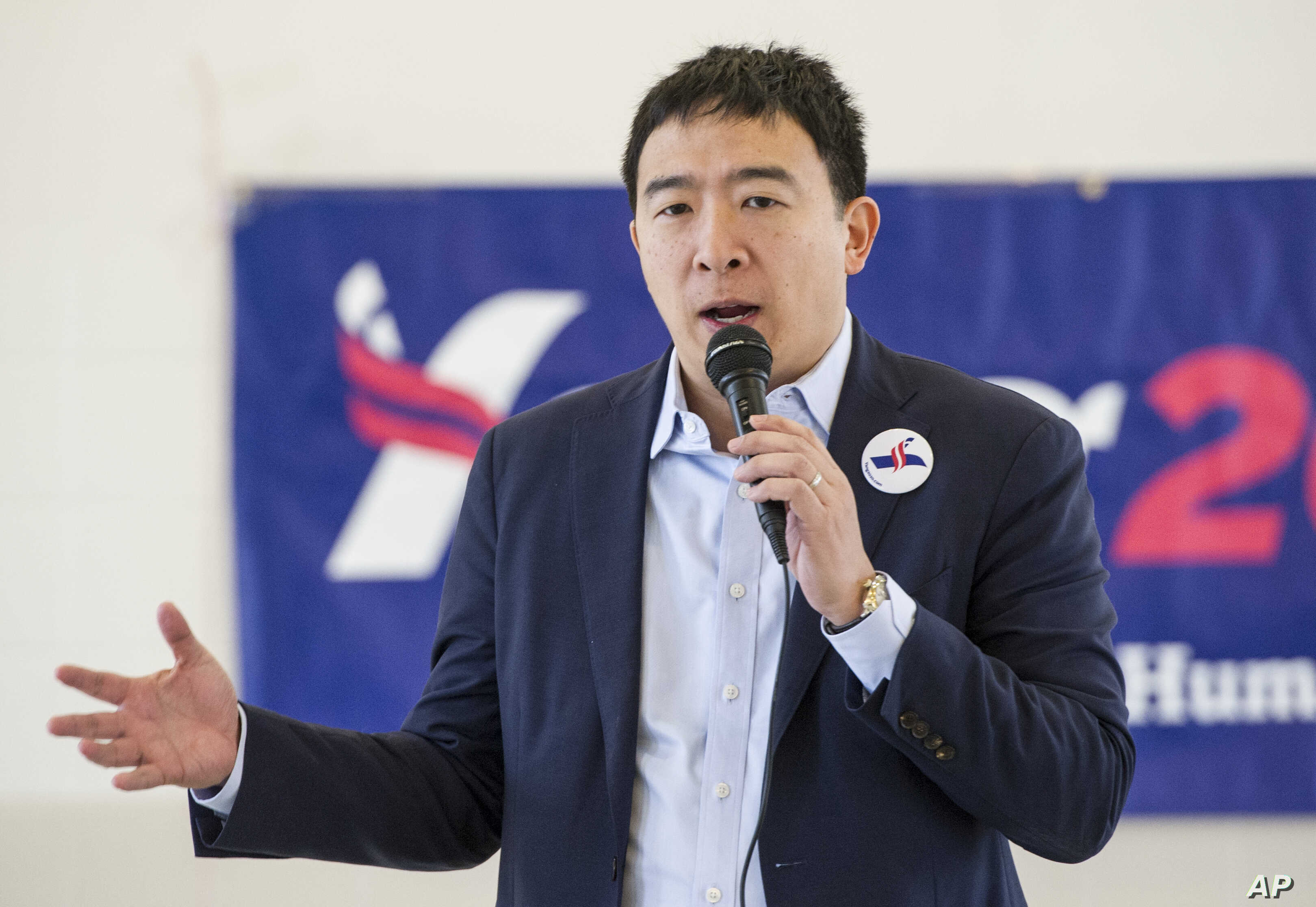 FILE - Andrew Yang, a candidate in the Democratic primaries for president, speaks at a town hall meeting in Cleveland, Feb. 24, 2019.