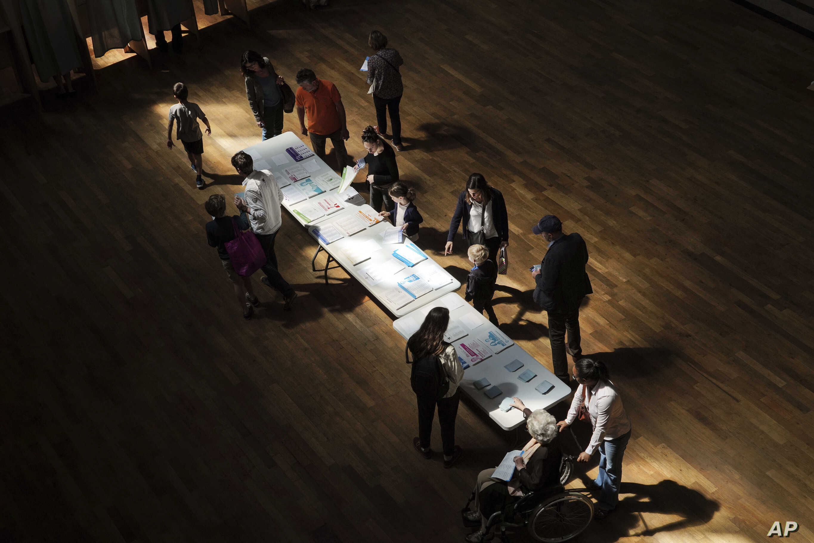 Voters pick up ballots before voting in Lyon, France, May 26, 2019.