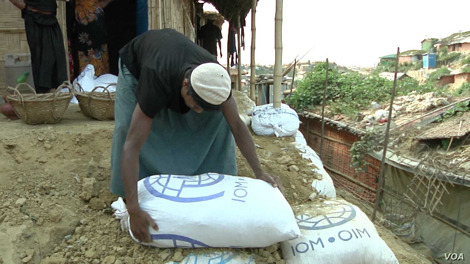 Refugees are using sandbags to shore up the hills in the refugees camps.