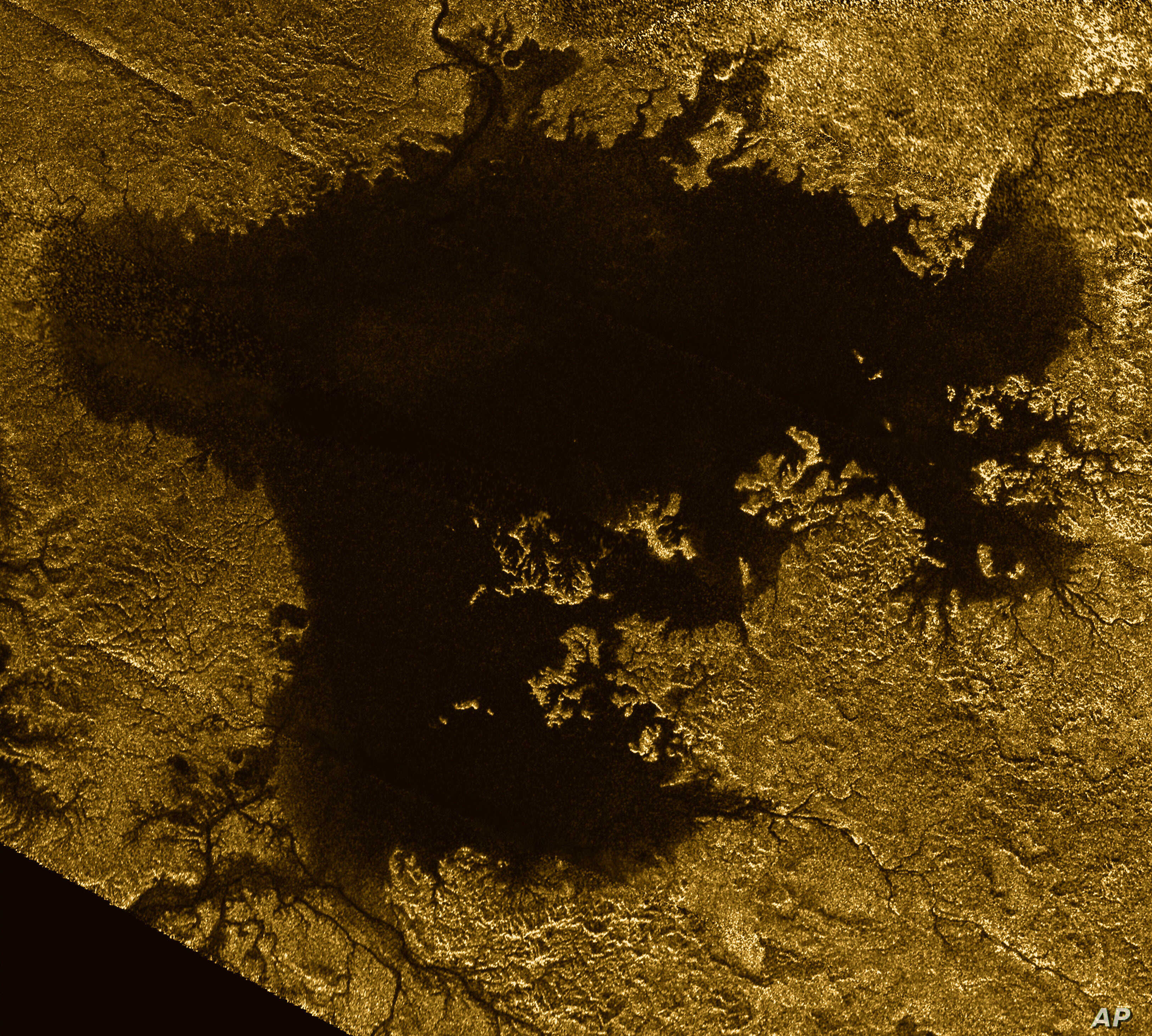 FILE - This 2007 image made available by NASA shows a hydrocarbon sea named Ligeia Mare on Saturn's moon Titan, as seen by the Cassini spacecraft.