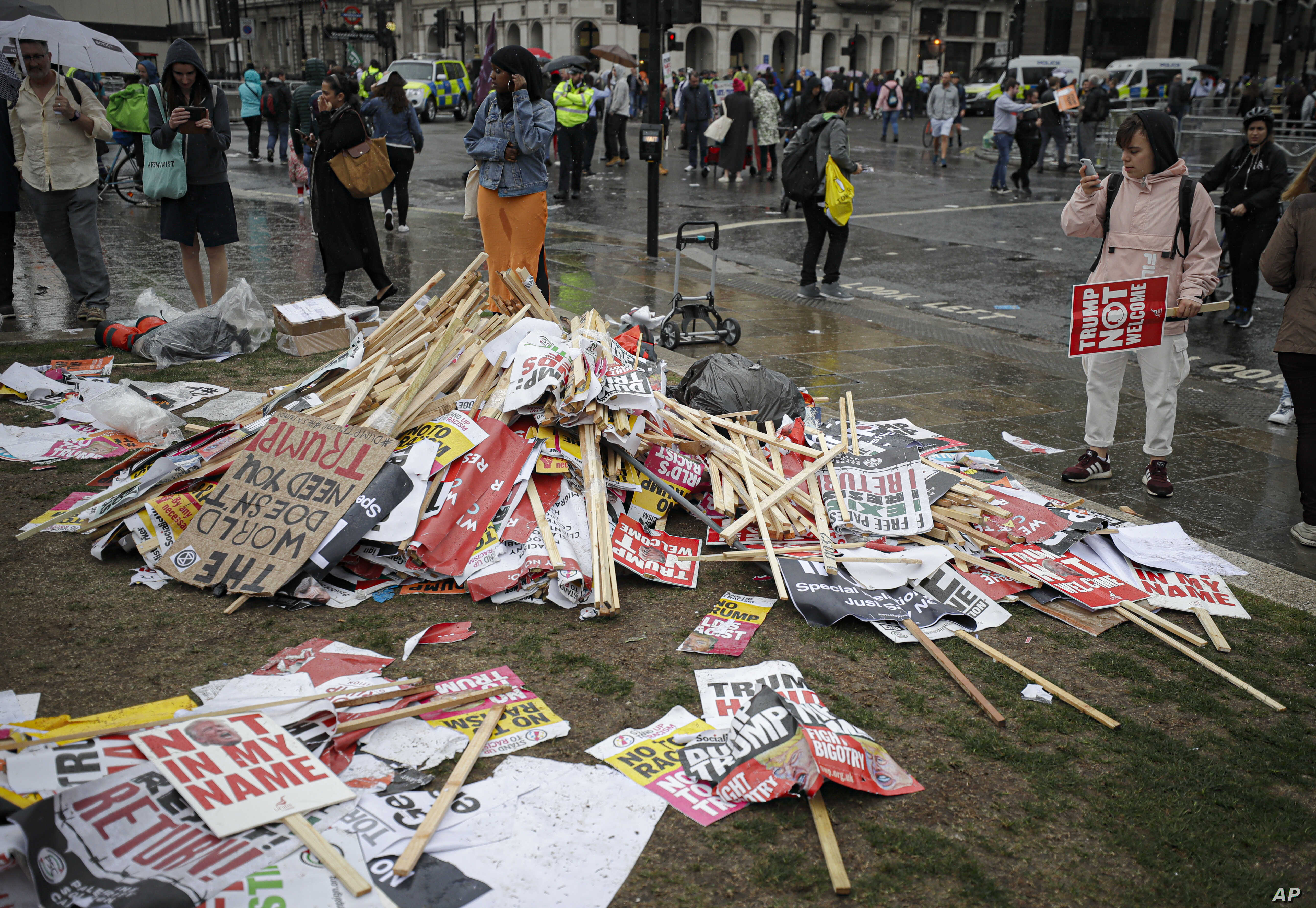 Placards showing anti-Trump messages lie on the ground, in central London, near the end of a protest against the state visit of President Donald Trump, June 4, 2019.