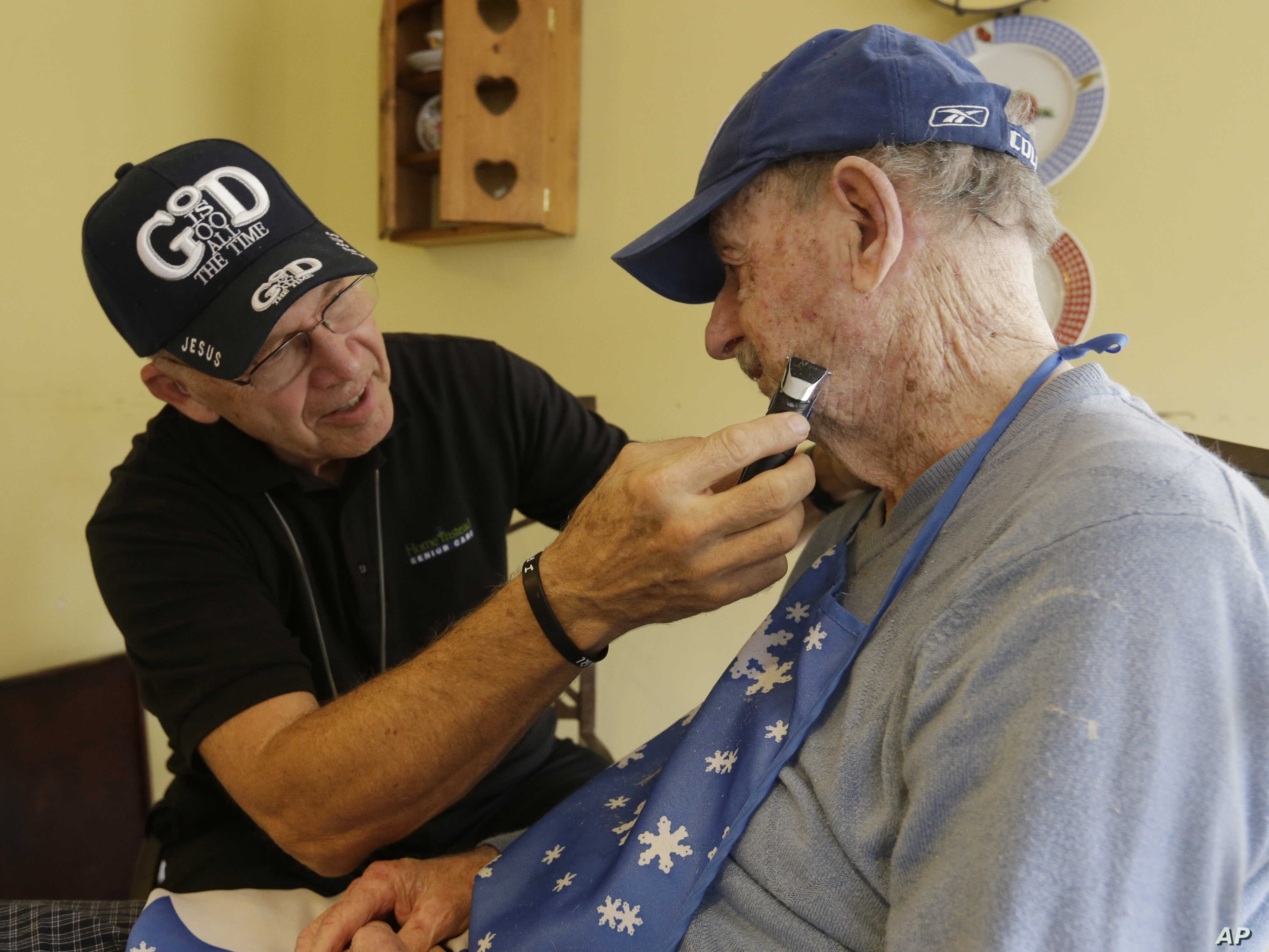 FILE -- Caregiver Warren Manchess, 74, left, shaves Paul Gregoline, 92, in Noblesville, Indiana. The share of the U.S. population over age 60 is expected to rise by 40 percent between 2010 and 2050.