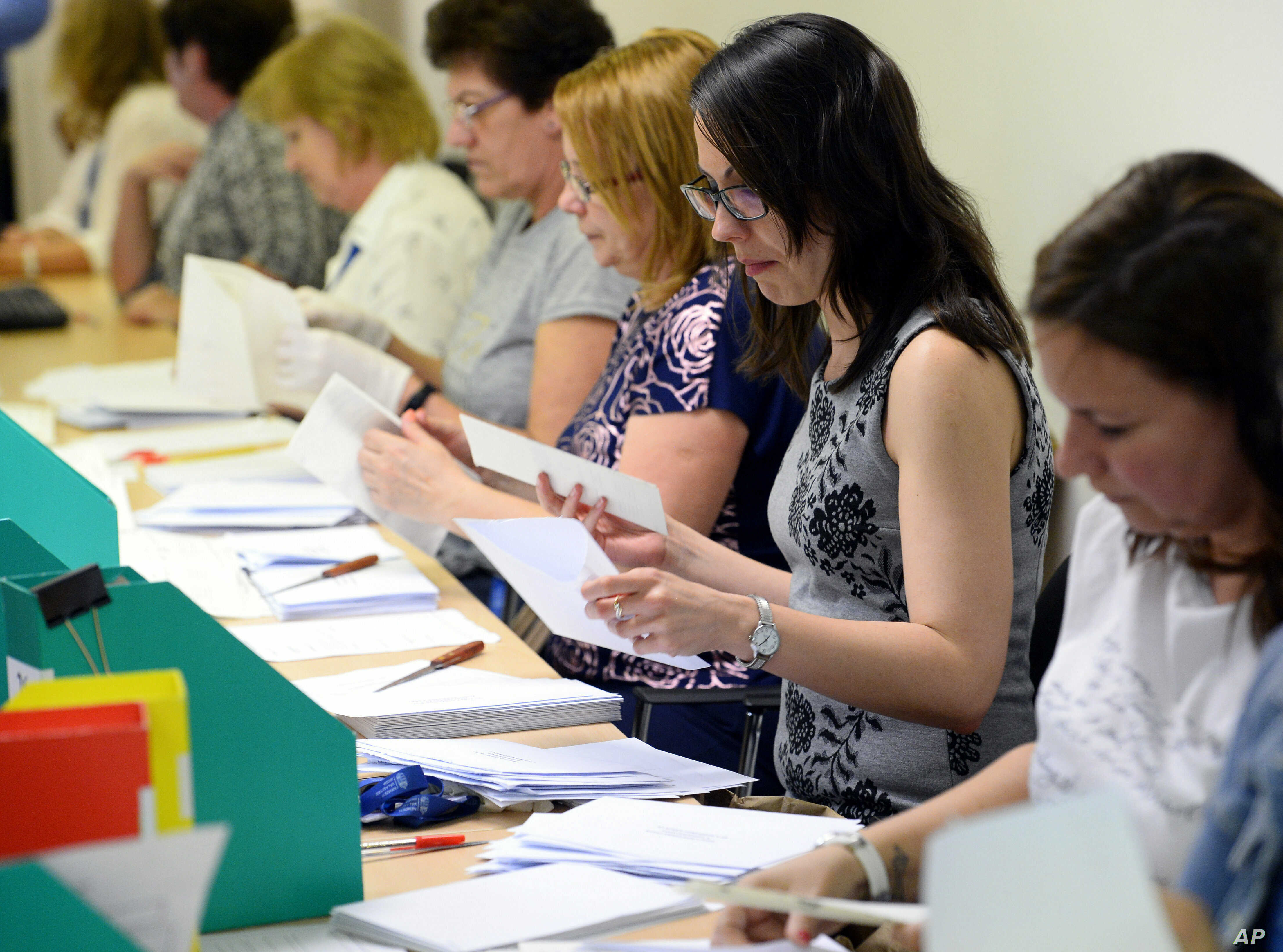 Election workers count mail-in ballots at the conclusion of European elections in Budapest, Hungary, May 26, 2019.