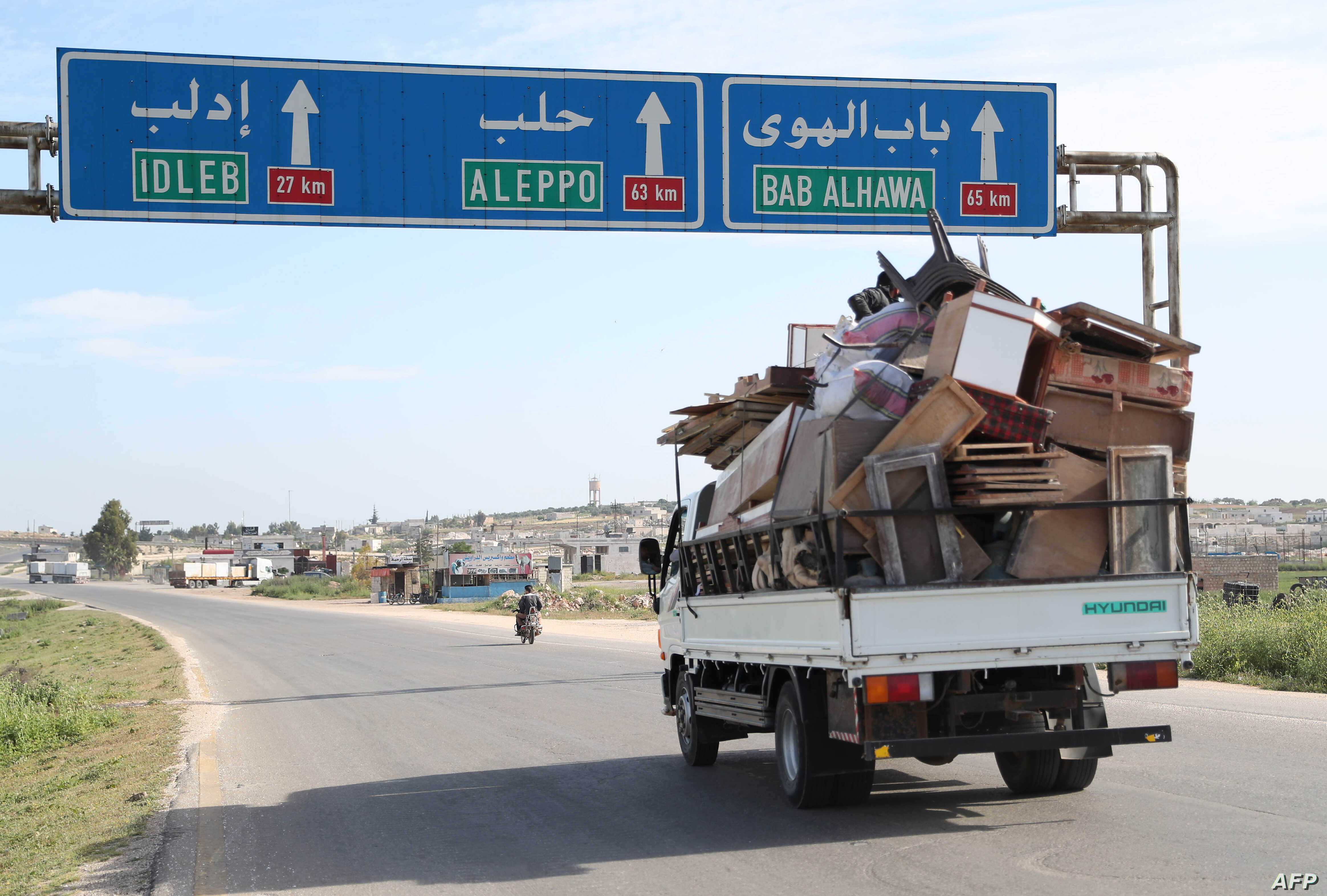 Residents flee with their belongings during reported shelling in rebel-held Idlib province, Syria, May 3, 2019.