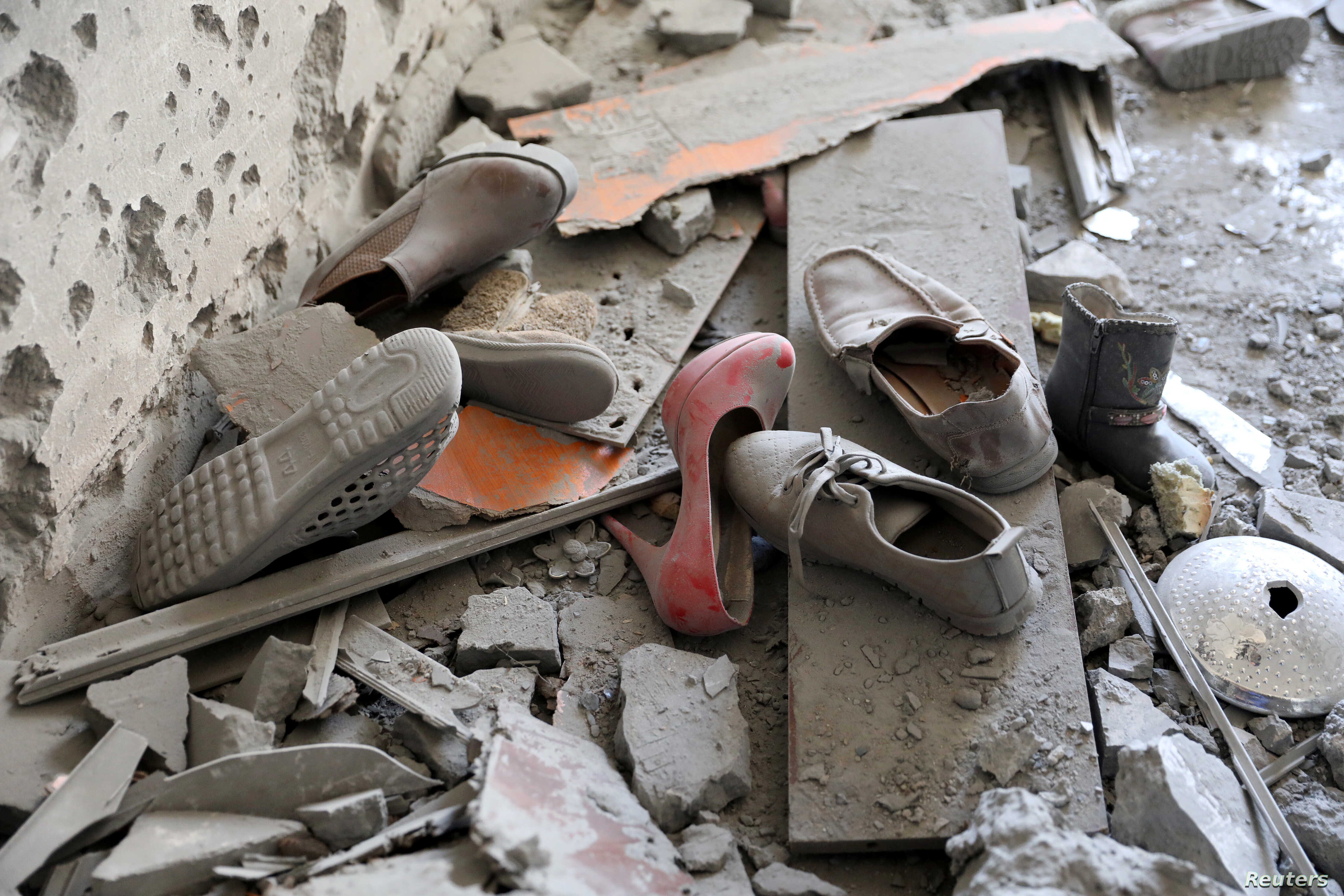 FILE - Shoes are pictured in a house damaged by shelling during the fighting between the eastern forces and internationally recognized government is pictured in Abu Salim in Tripoli, Libya, April 15, 2019.