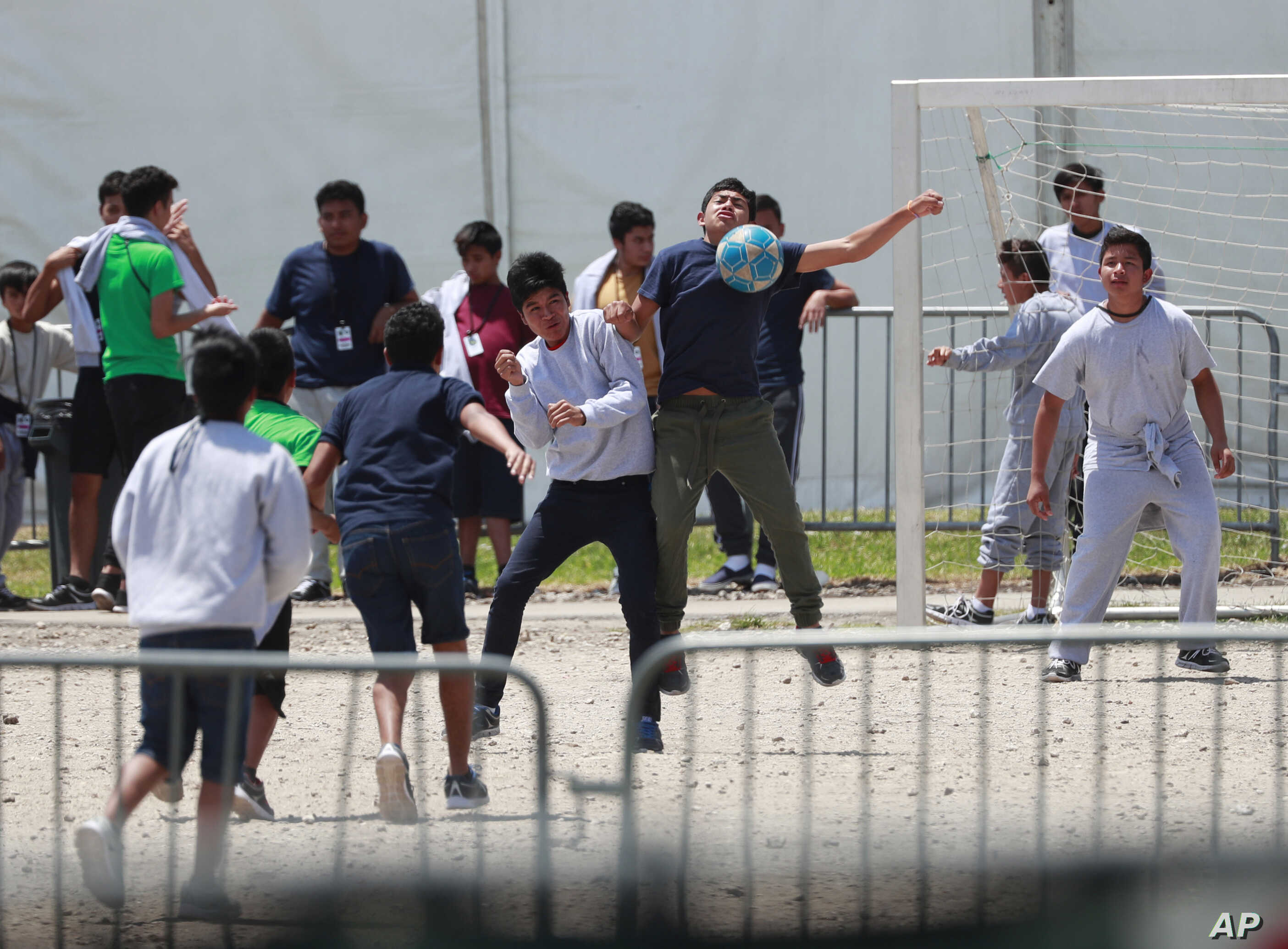 FILE - Migrant children play soccer at the Homestead Temporary Shelter for Unaccompanied Children in Homestead, Fla., April 19, 2019.
