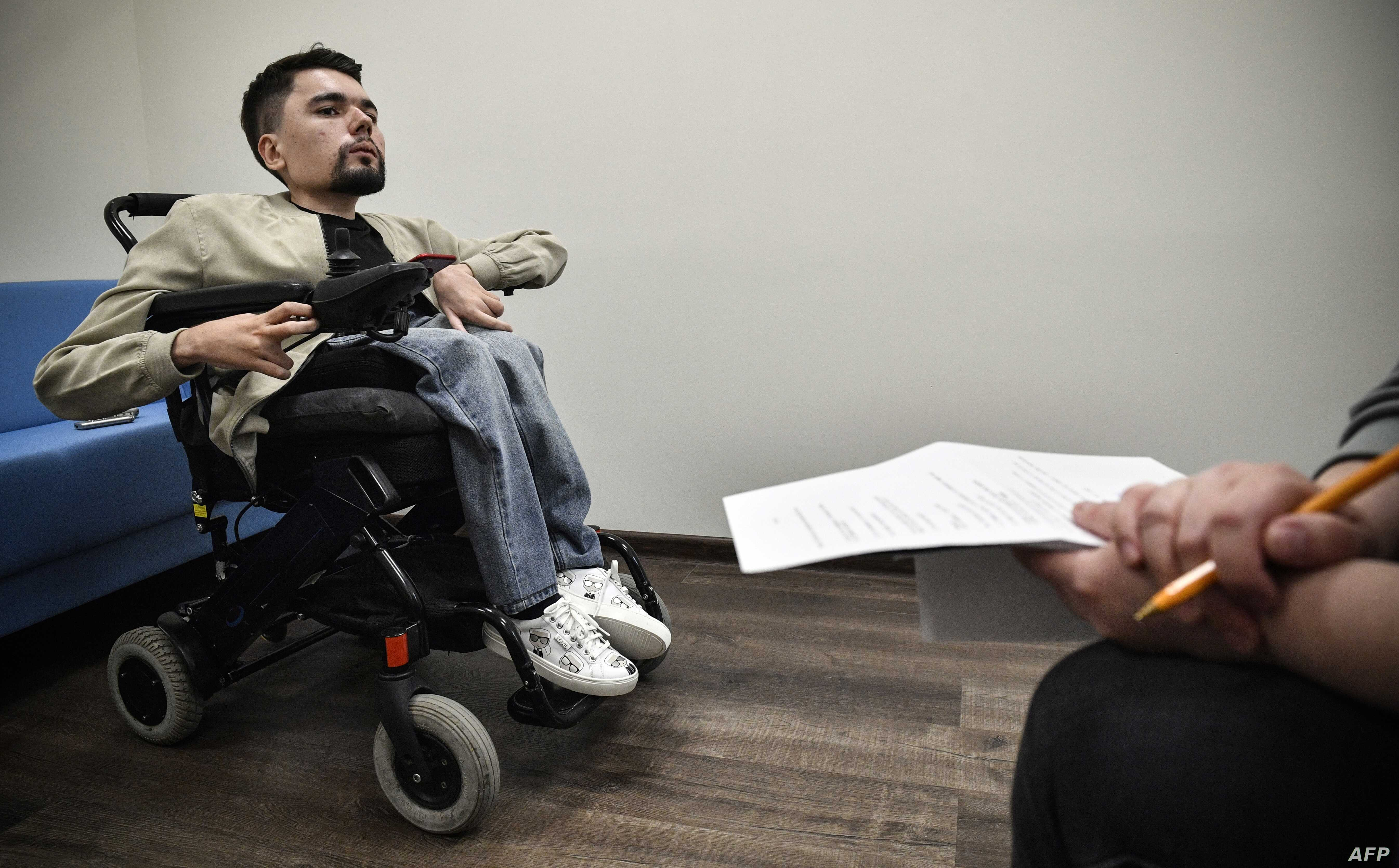 Alexander Gorbunov talks to AFP correspondent during an interview in Moscow, May 3, 2019. Diagnosed with spinal muscular atrophy and using his right index finger to type. StalinGulag has built a nearly 1.5 million army of followers on Twitter and Tel...