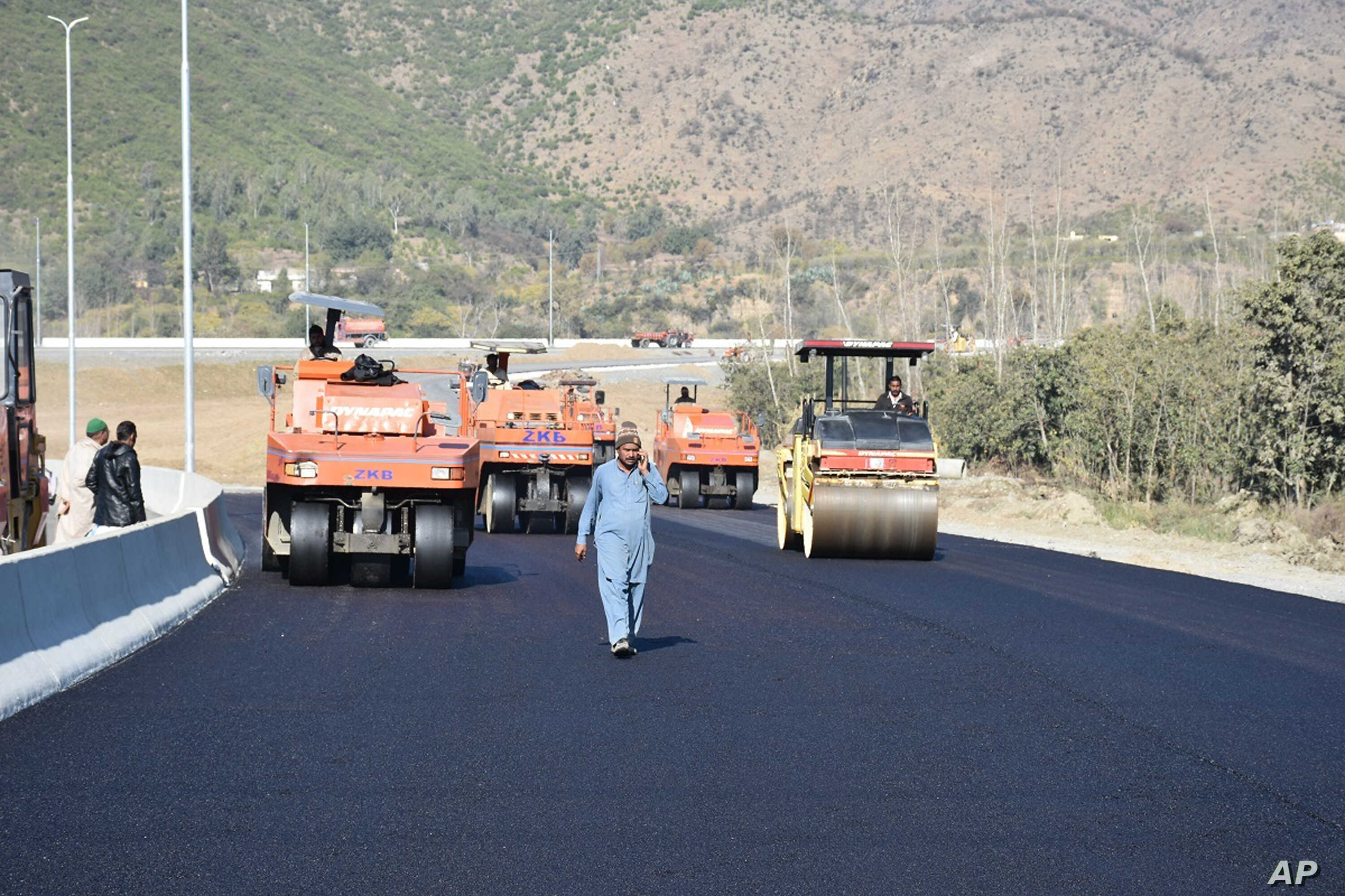 """FILE - Road construction is underway as part of China's """"Belt and Road"""" Initiative, in Haripur, Pakistan, Dec. 22, 2017."""