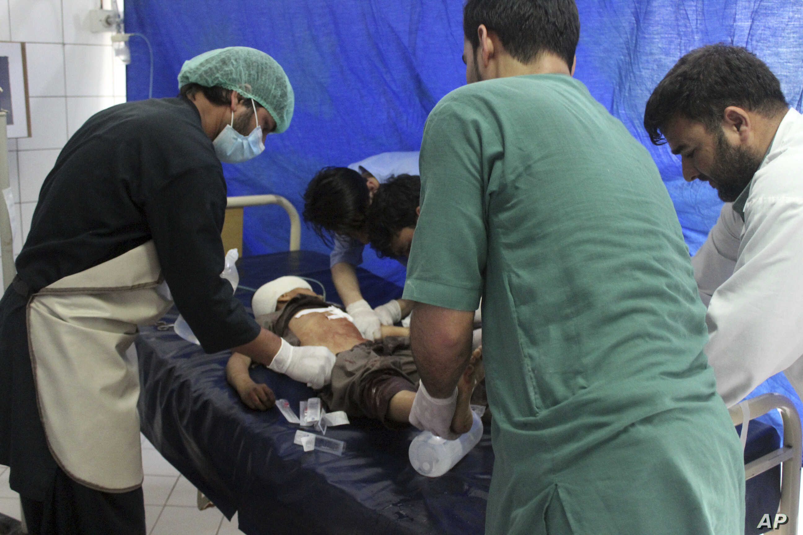 An injured boy receives treatment at a hospital after a clash between Taliban and security forces in Kunduz province,  Afghanistan, April 13, 2019.