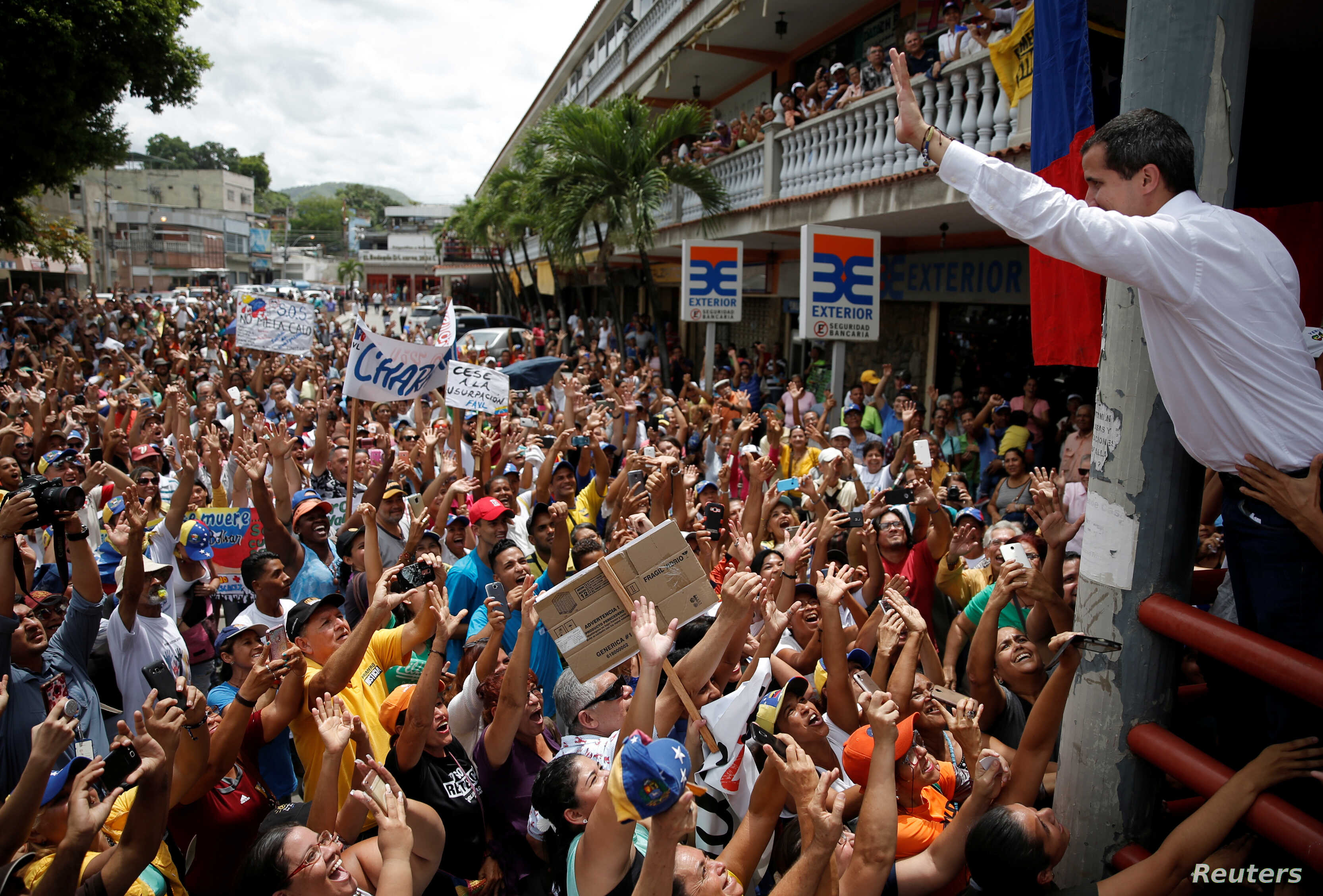 FILE - Venezuelan opposition leader Juan Guaido, who many nations have recognized as the country's rightful interim ruler, greets supporters during a gathering in Charallave, Venezuela, June 8, 2019.