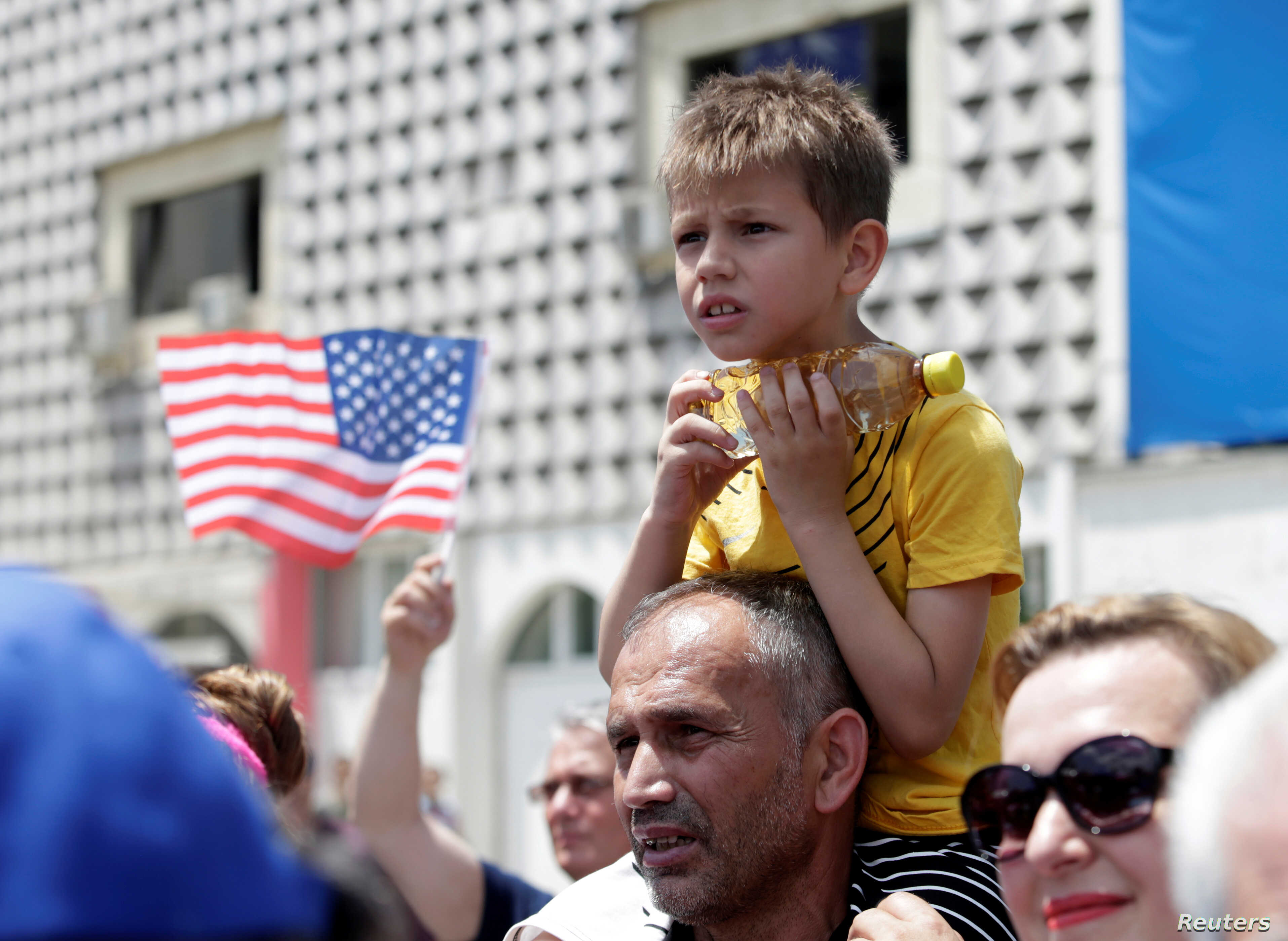 A boy looks on during the 20th anniversary of the deployment of NATO Troops in Kosovo in Pristina, Kosovo, June 12, 2019.