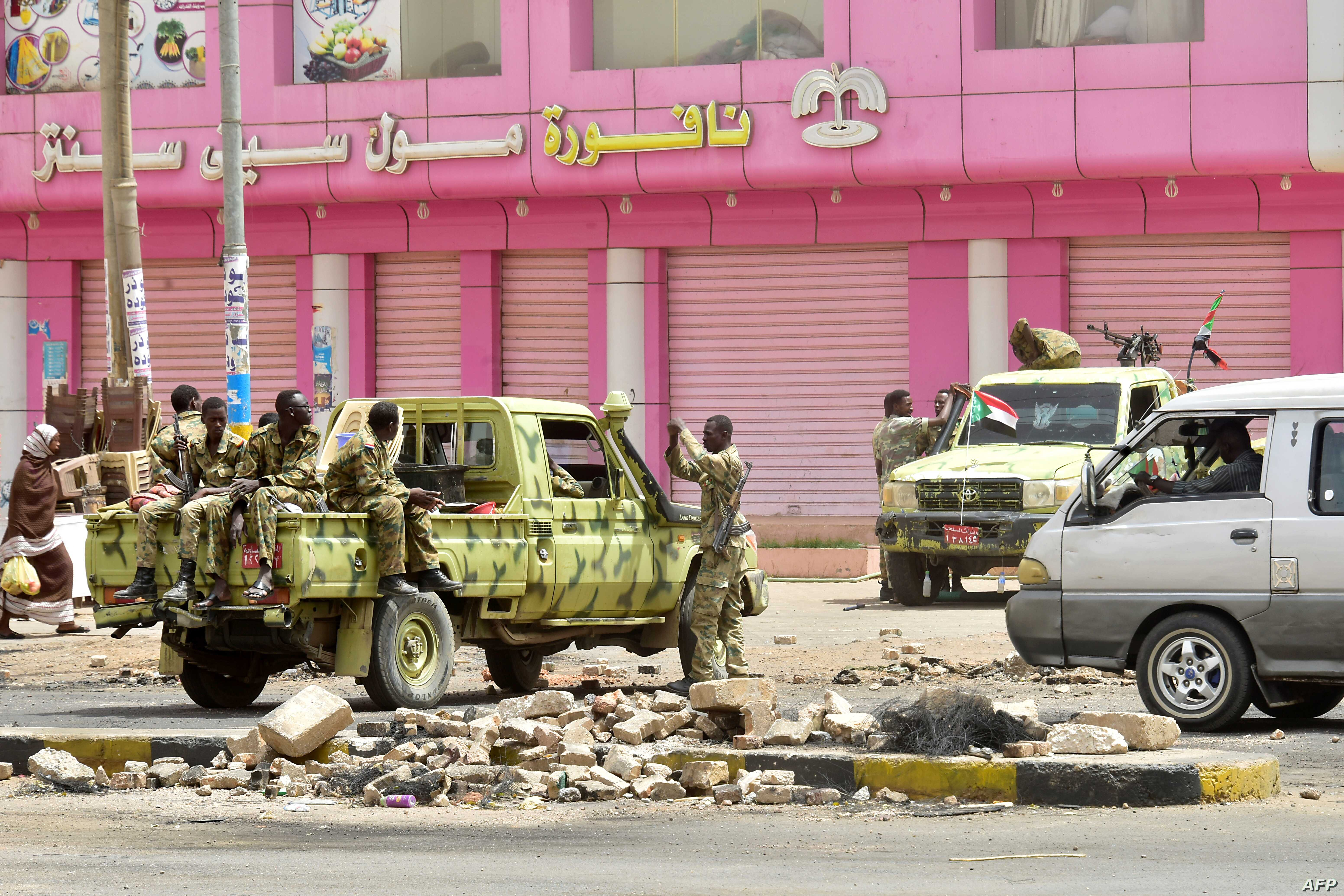 Sudanese soldiers stand guard a street in Khartoum,  June 9, 2019.