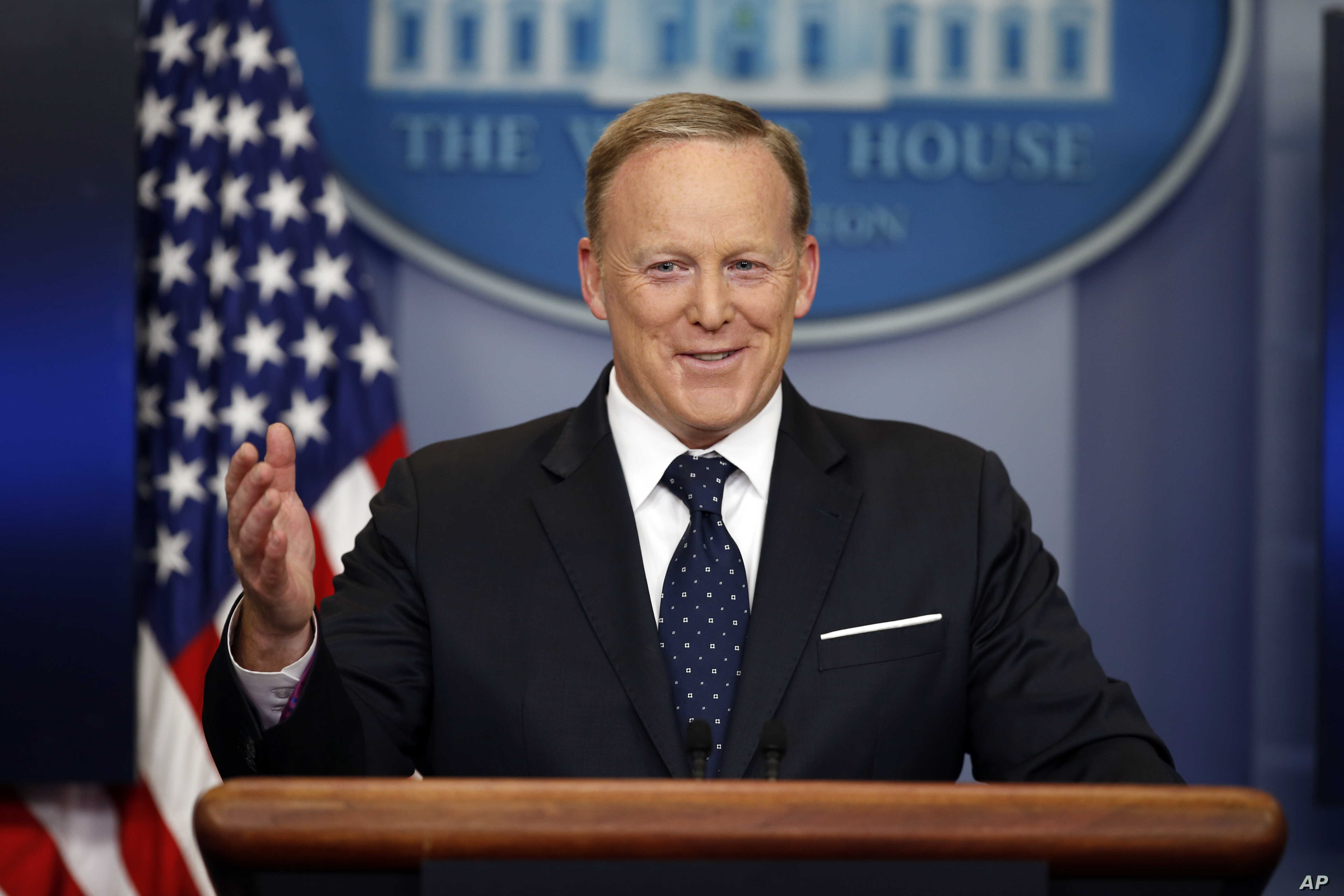 FILE - Then-White House press secretary Sean Spicer smiles as he answers a question during a briefing at the White House, in Washington, June 20, 2017.
