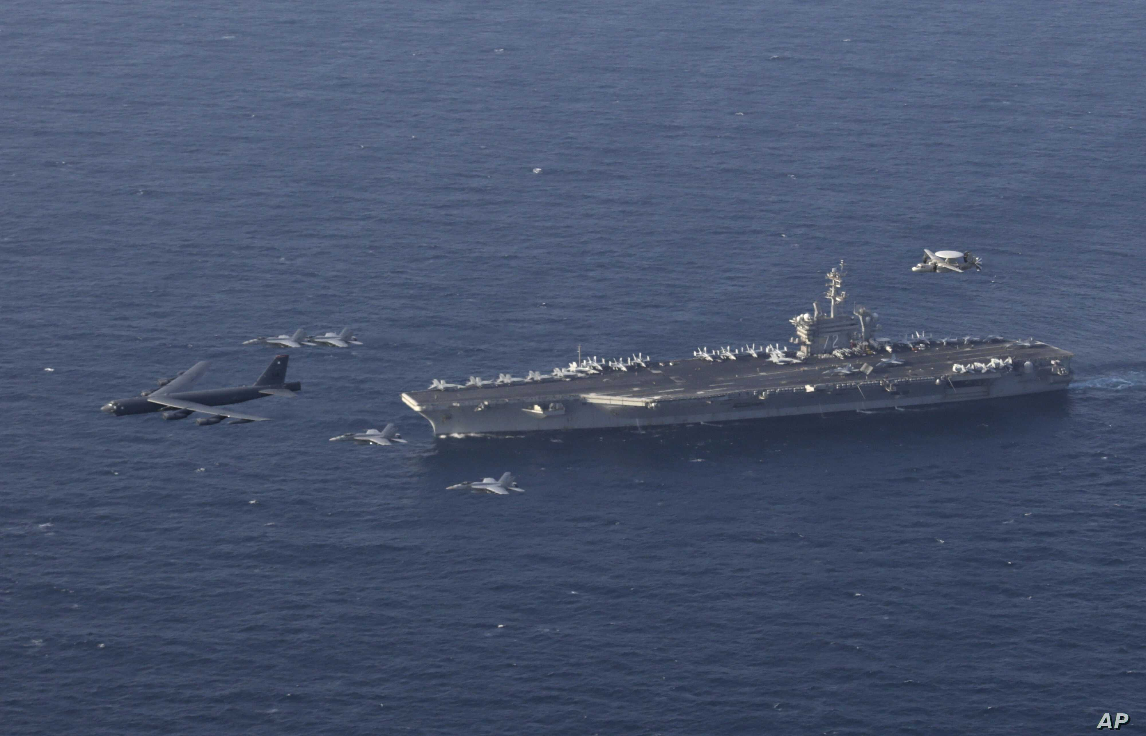 The USS Abraham Lincoln aircraft carrier and a U.S. Air Force B-52H Stratofortress conduct joint exercises in the Arabian sea, June 1, 2019.
