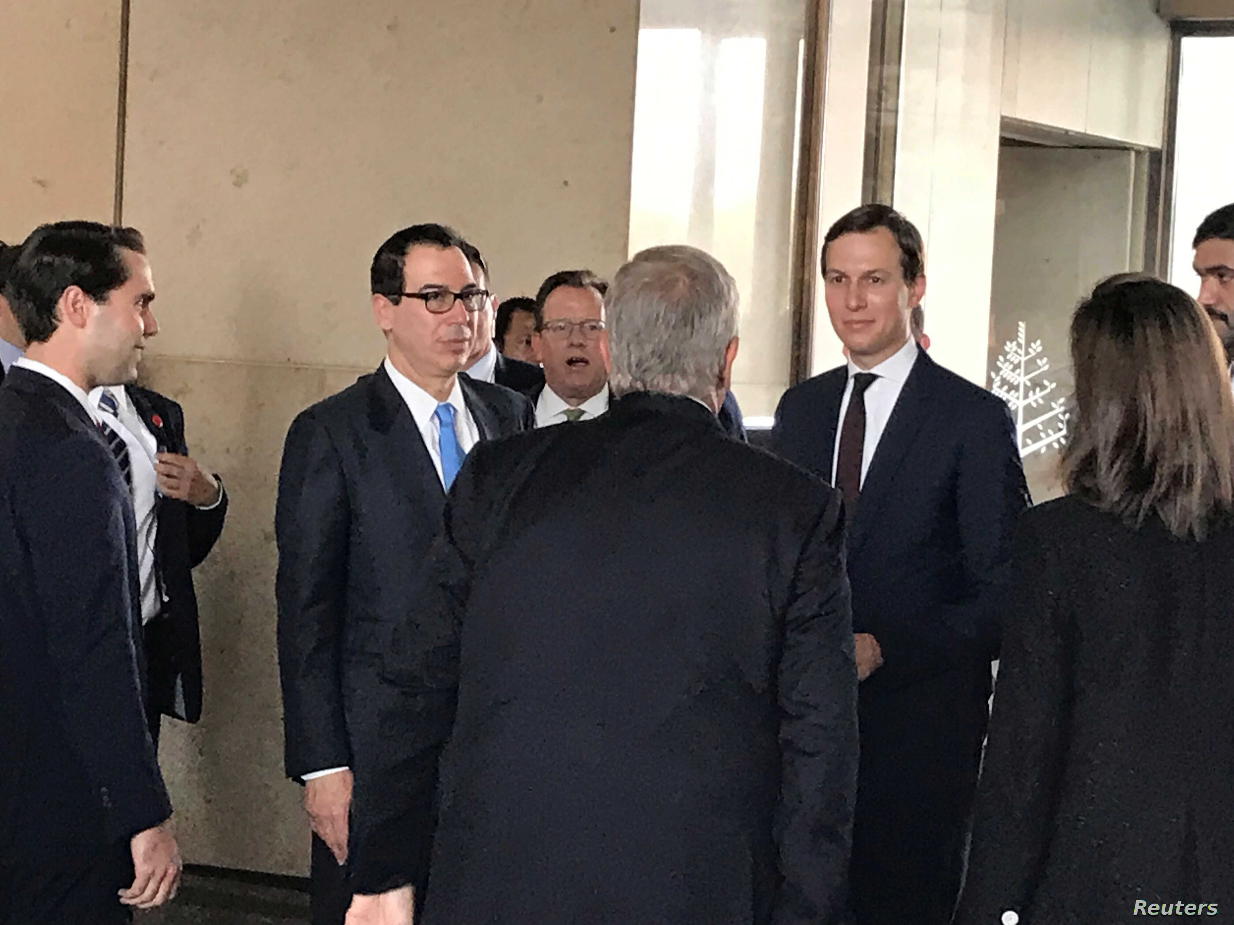 "White House senior adviser Jared Kushner and Treasury Secretary Steven Mnuchin arrive at Manama's Four Seasons hotel, the venue for the U.S.-hosted ""Peace to Prosperity"" conference, in Manama, Bahrain, June 25, 2019."