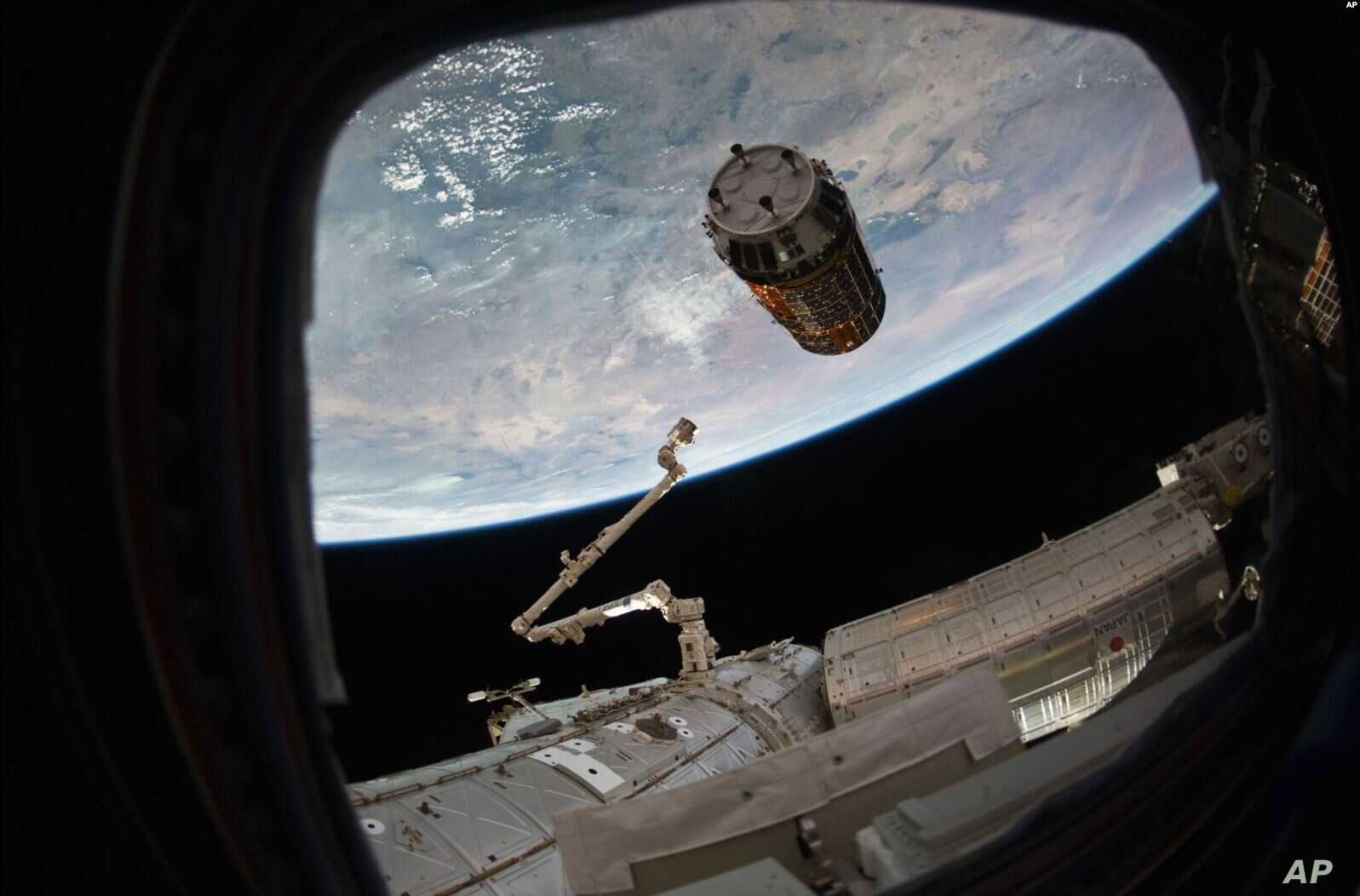 FILE - A photo provided by NASA TV shows a cargo ship as it arrives at the International Space Station, Dec. 13, 2016.