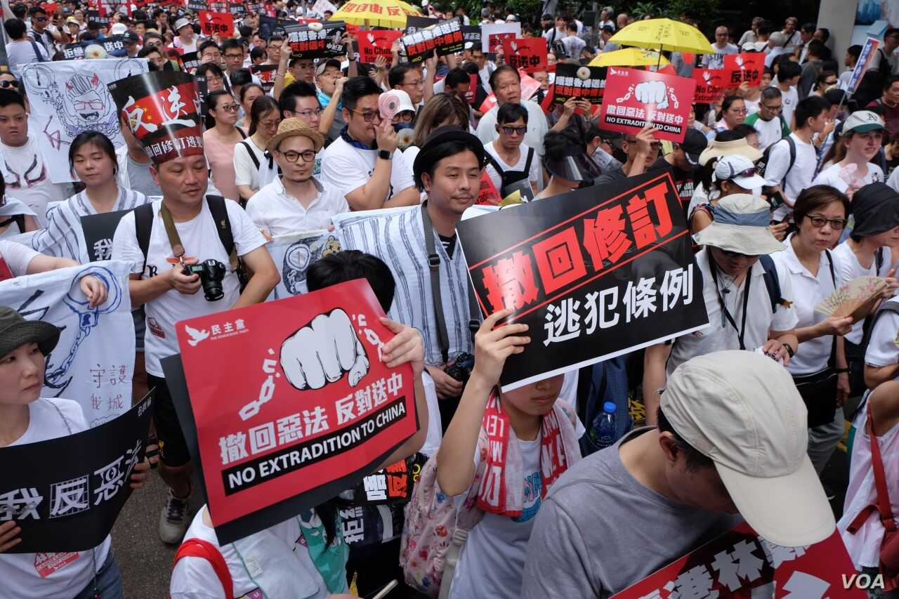 Many protesters call for Chief Executive Carrie Lam's resignation in Hong Kong, June 9, 2019, at a demonstration against extradition to China.