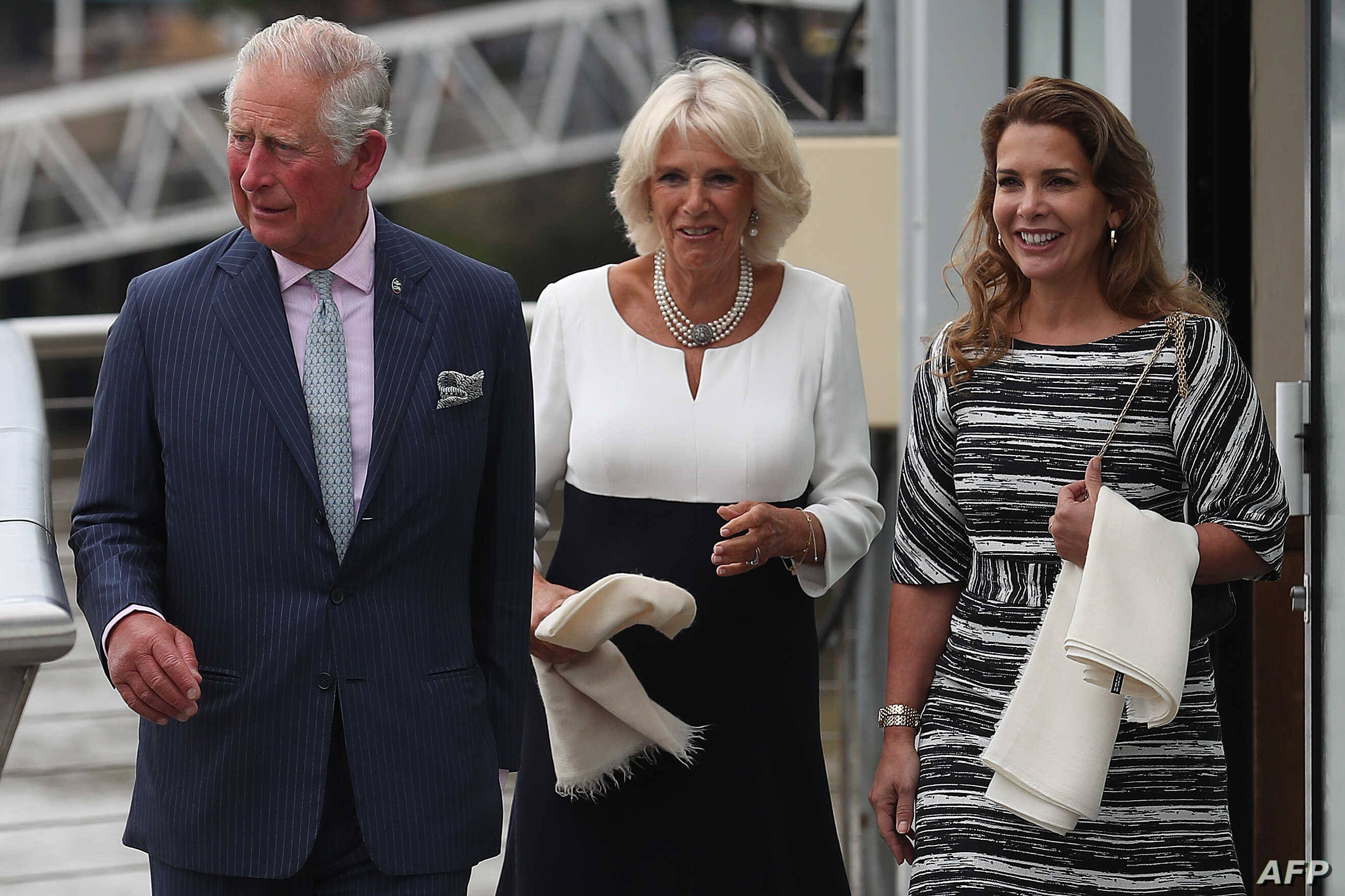 FILE - Britain's Prince Charles, Prince of Wales, left, and his wife Britain's Camilla, Duchess of Cornwall, center, walk with Jordan's Princess Haya bint al-Hussein in London, Sept. 5, 2018.